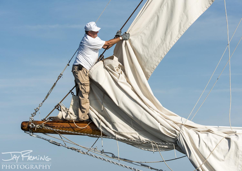 A crew member on the  Rebecca T. Ruark  prepares the jib
