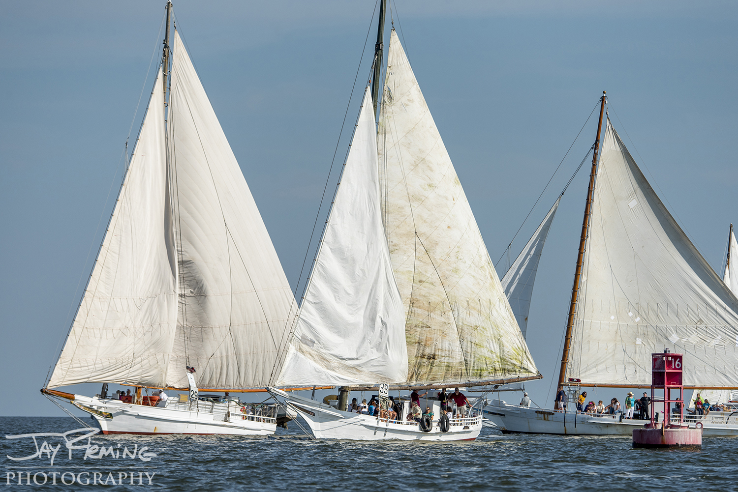 Skipjacks tack around the 16-buoy in Tangier Sound to head south on the second leg of the race