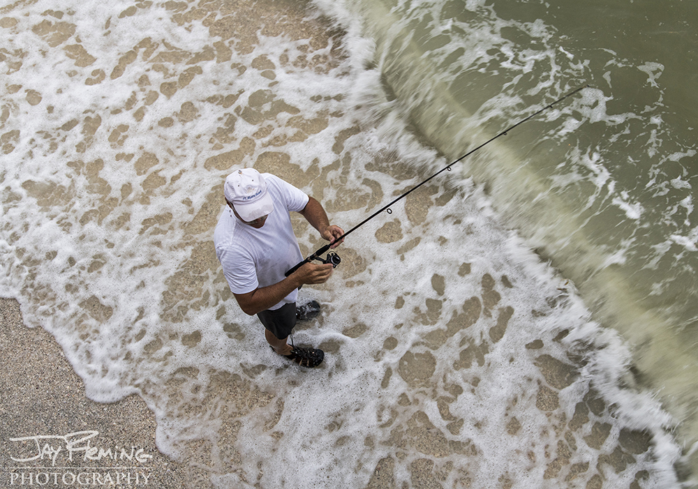 Fishing in the Gulf of Mexico on Sanibel Island near Blind Pass - the inlet that divides through Sanibel and Captiva Islands