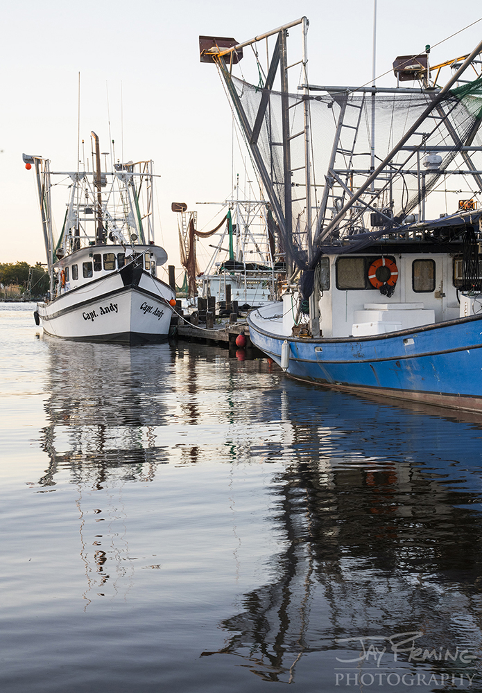 Shrimp trawlers lined up at a packing house in Dulac, Louisiana waiting for the start of the inshore Brown and White Shrimp season to open on May 1st.