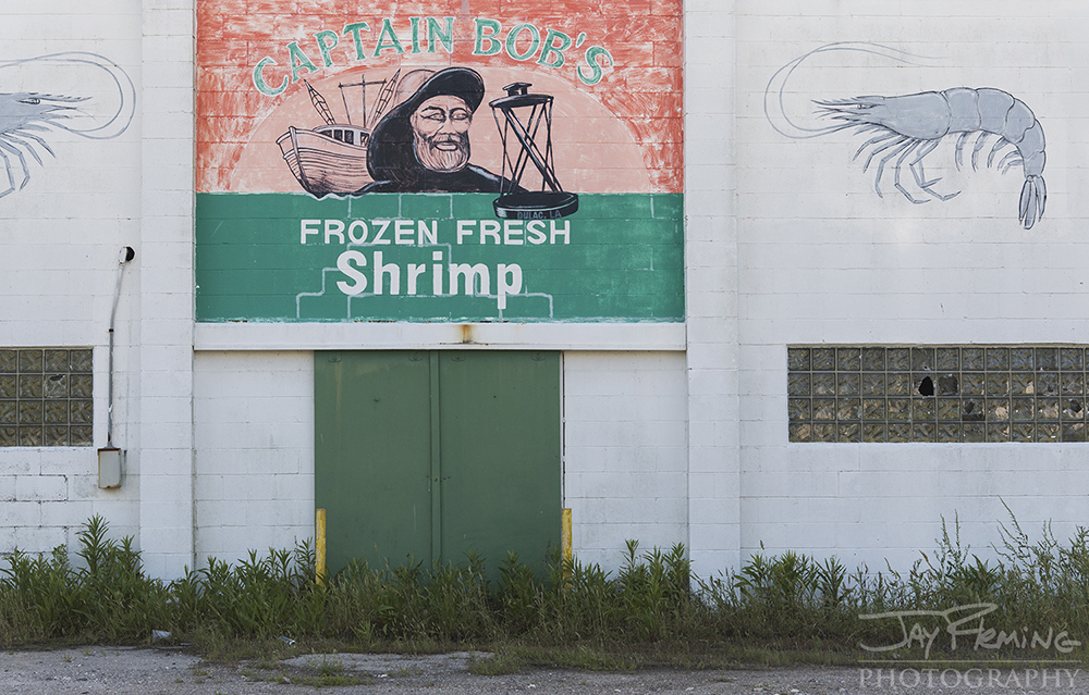 An abandoned shrimp packing house in Dulac. The shrimp industry peaked in the 1970's and 1980's - supporting dozens of processing facilities and thousands of boats in Southern Louisiana. Shrimp imported from overseas, increased cost of operating and pressures from regulation have caused the industry to decline in the last three decades.