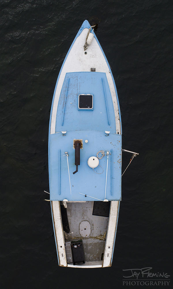 Aerial view of a workboat moored in the harbor at Matinicus Island.