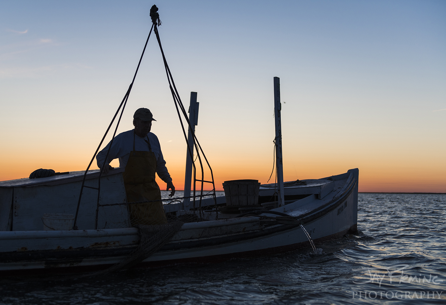 Smith Island waterman, Jessie Brimer, putting his crab scrape out at first light in 'North End Bottom'