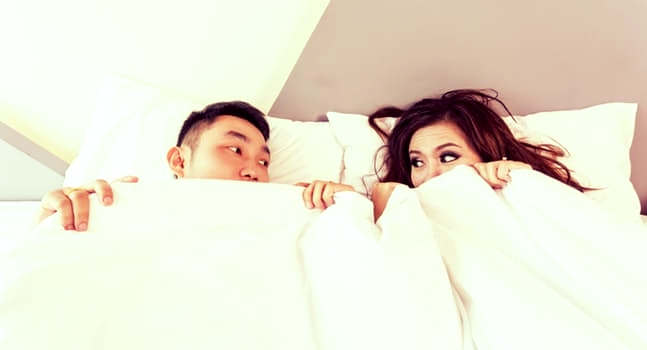couple in sheets.jpeg