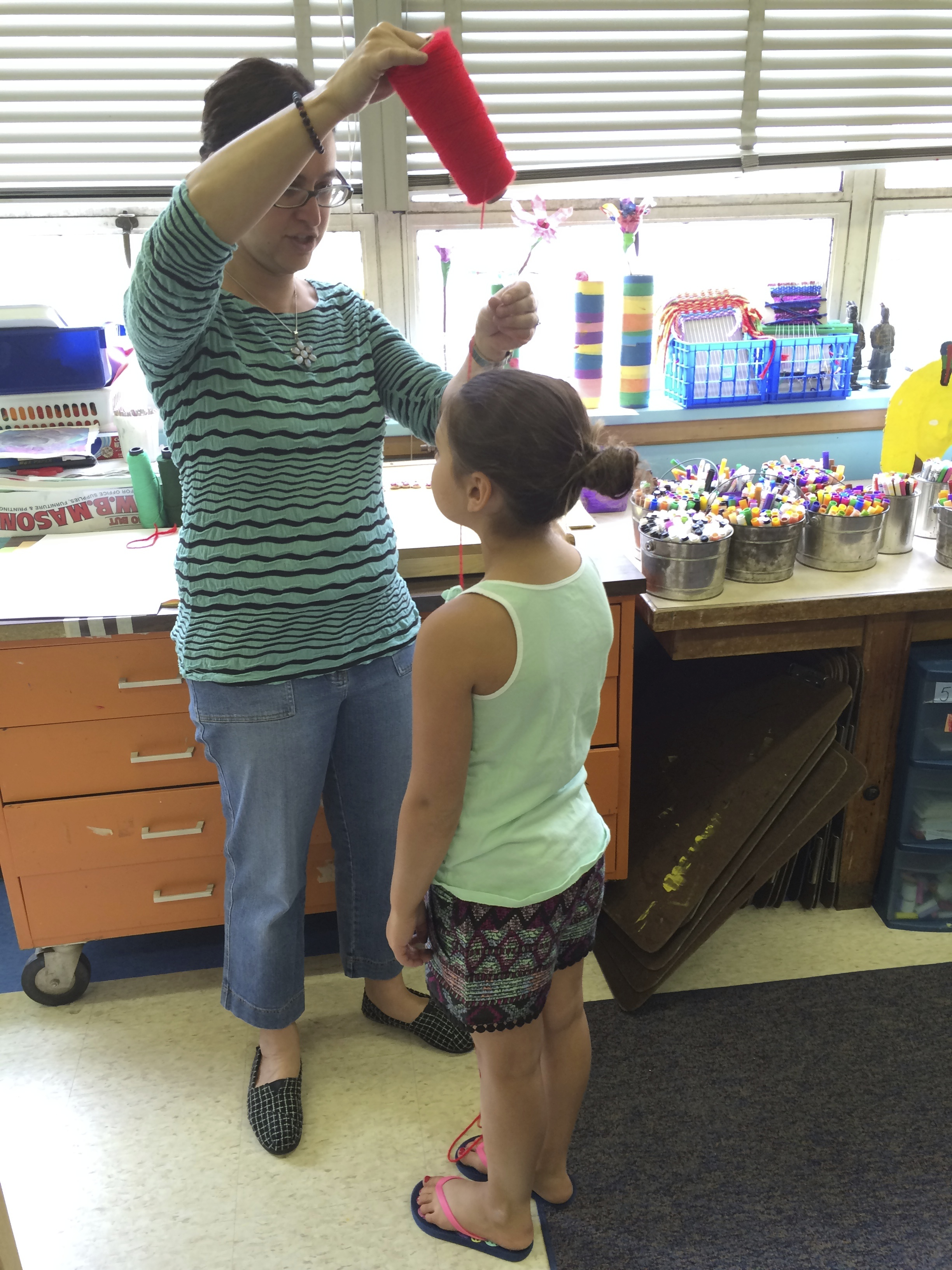 Measuring a student for  Forget-Me-Not