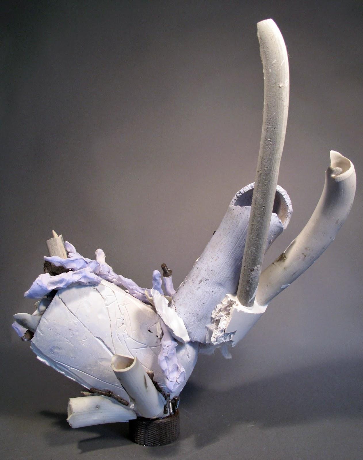 "Milk Bone Balance  , clay, plaster, silicone and found objects, 21""x21""x7"""
