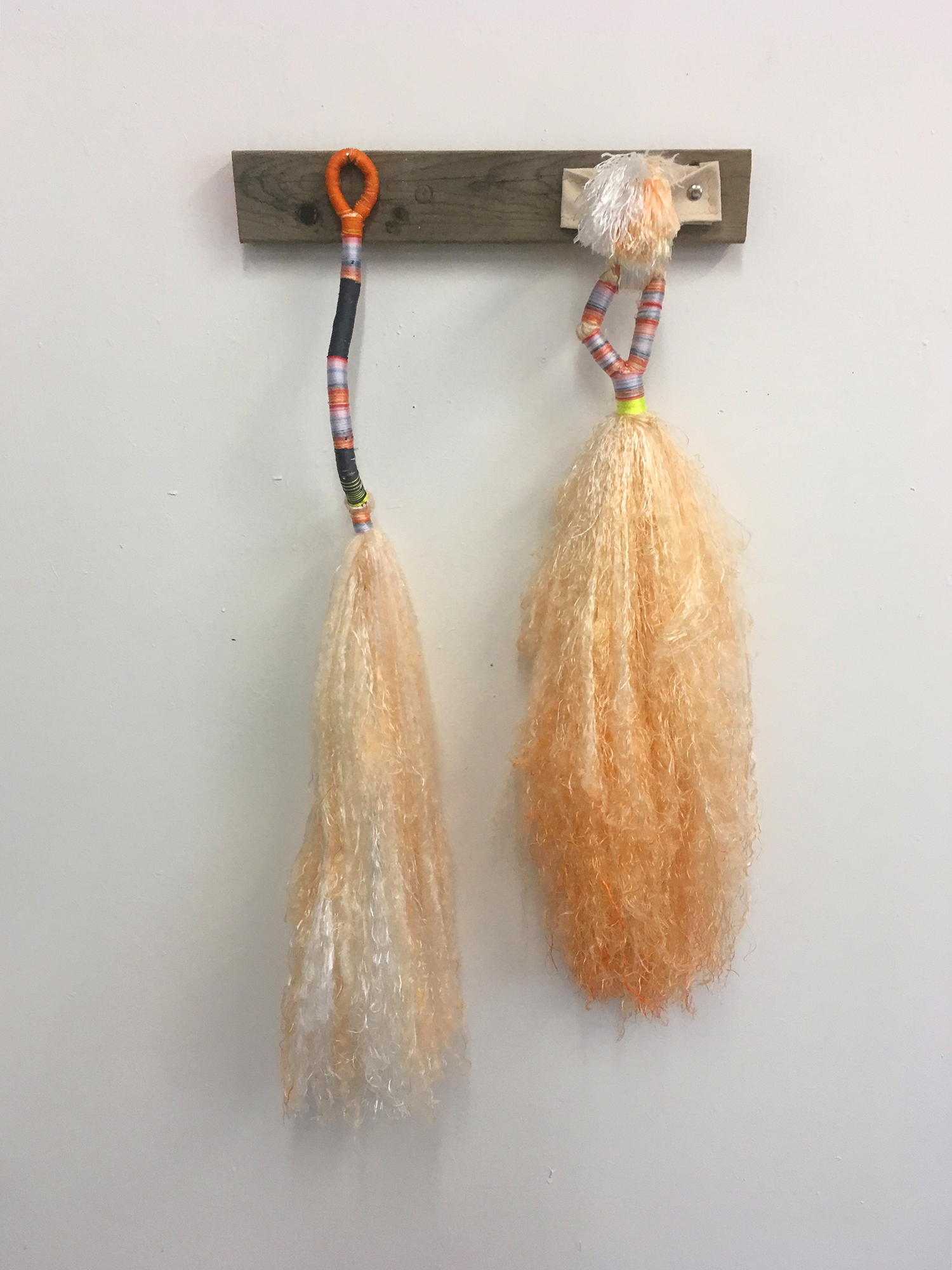 Daniel Zeese,  Two Orange Brooms,  bound dyed nylon and canvas fixture, 36x24x6