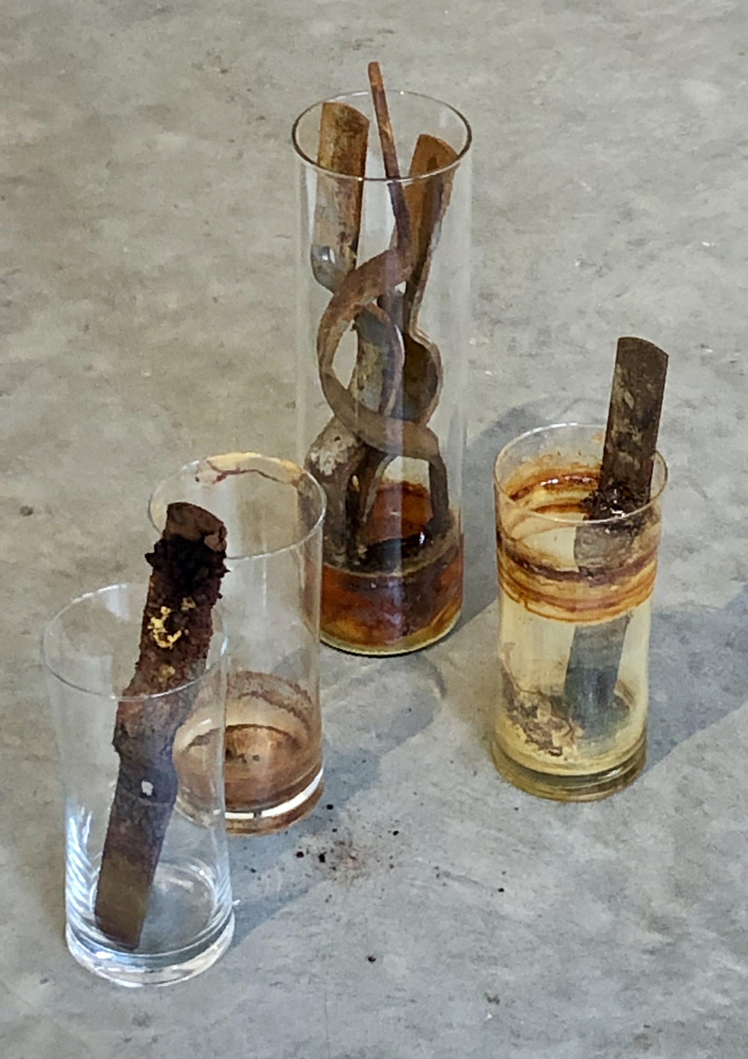 Rust Farm Installation , glass vessels, pipe strap, vinegar, salt, water