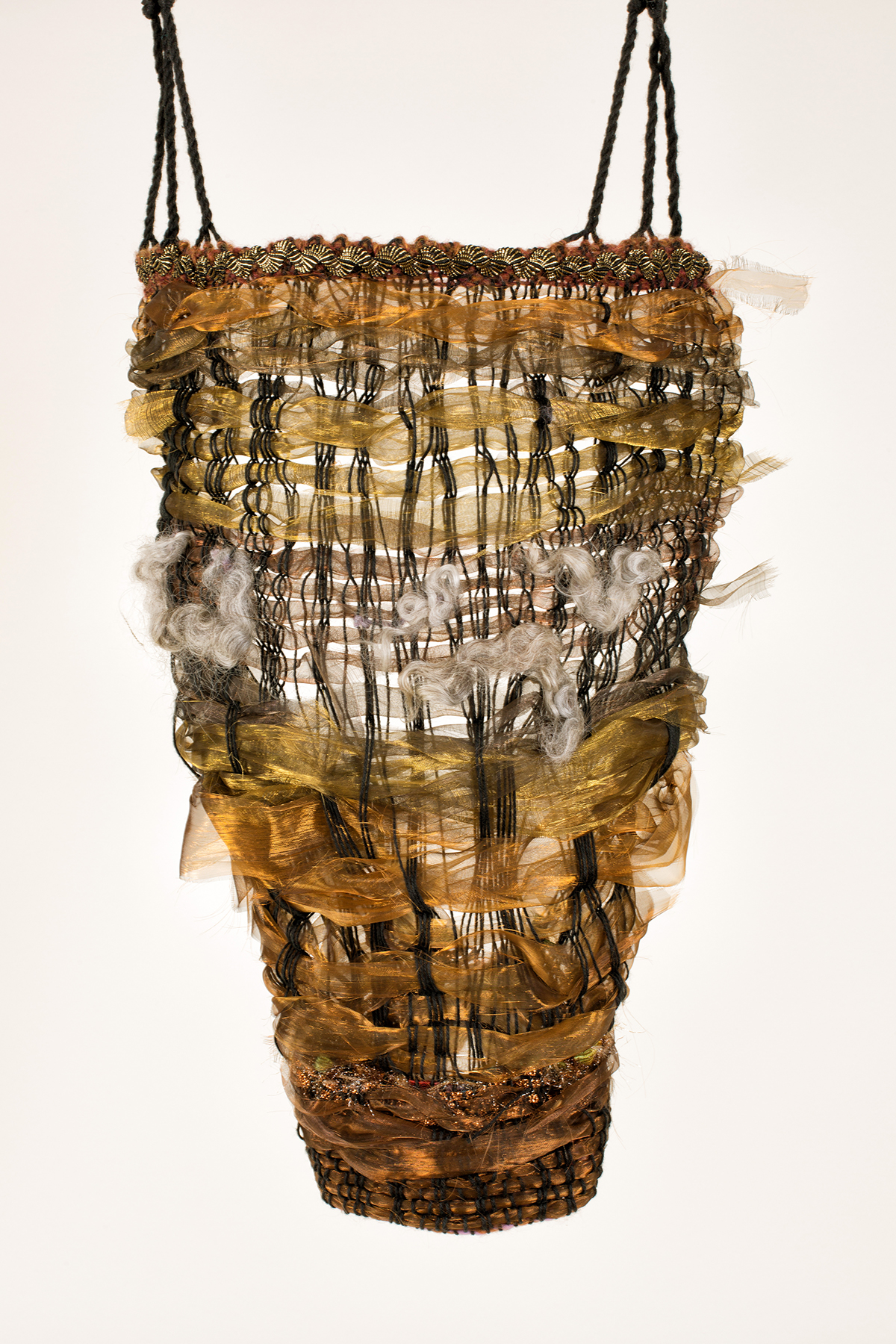 Sylvia Vander Sluis,  Torso,  Handwoven fiber, fabric, and cord, 21x14x4
