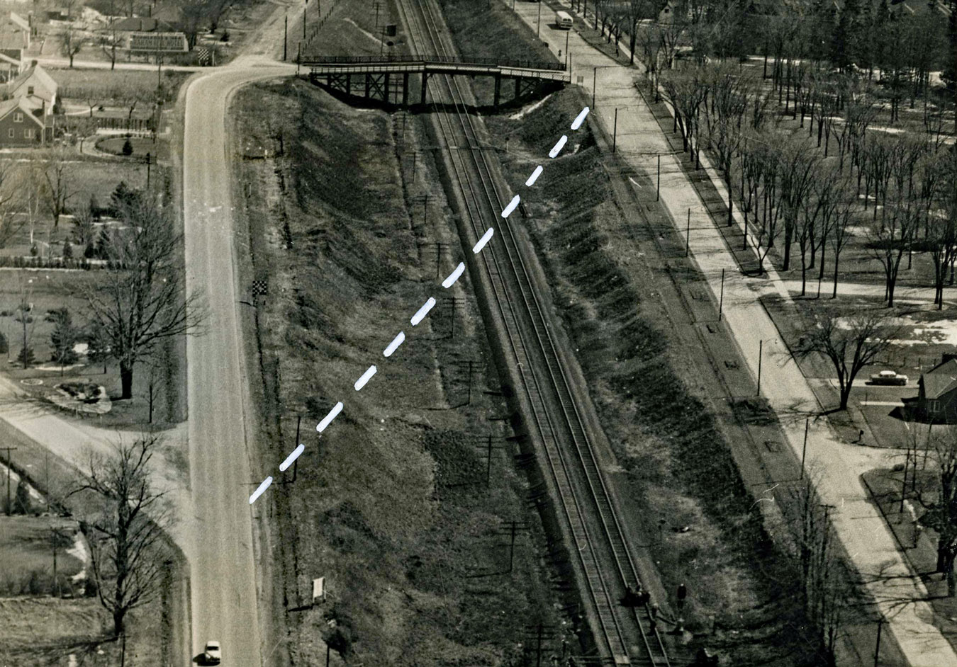 Ava Road Bridge.  Image courtesy of the Brant Historical Society   The dashed line identifies the proposed route of the new bridge to cross the Canadian National Railway's mainline tracks connecting Brant Ave with Paris Road. The new bridge opened in 1959.