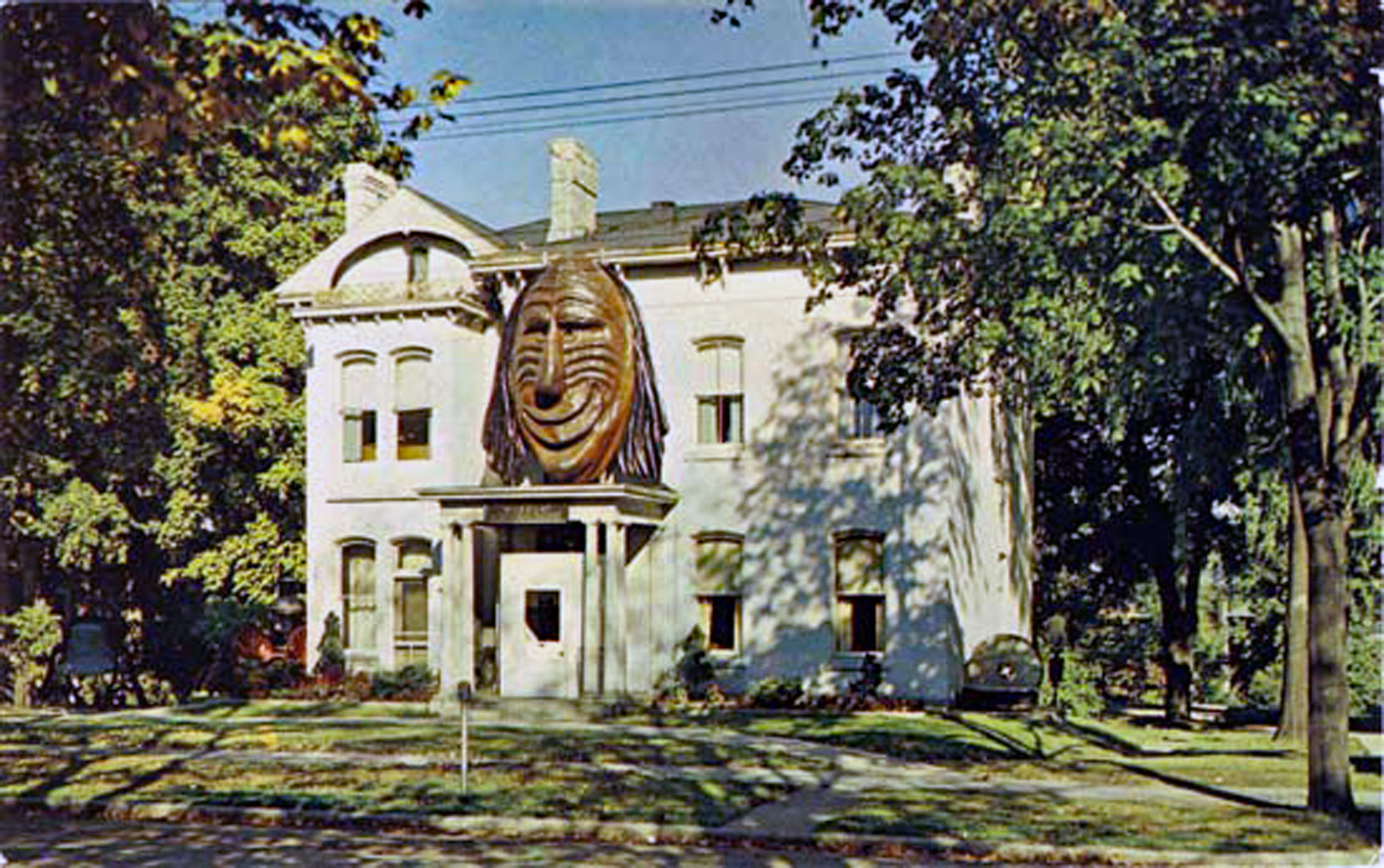 Brant County Museum in 1960. The Aboriginal Mask was added over the front door in 1959. An addition was added to the north side of the building (left side) and opened in November-1966. The Mask was removed from the museum in 1996.  Image courtesy of the Brant Historical Society
