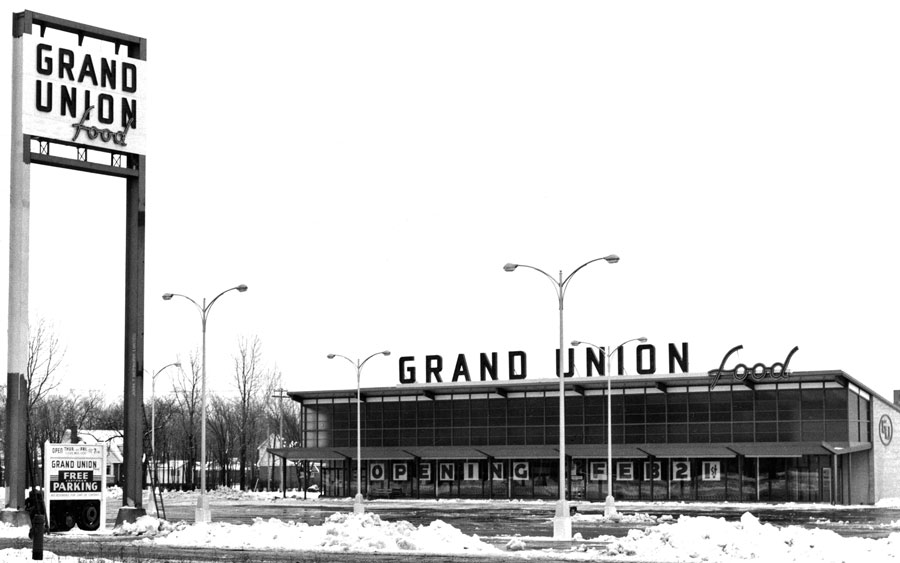 The Grand Union Super Market opened in February-1956. It was located next to Pauline Johnson Collegiate. The super market became a Steinberg's in 1958. The plaza was built out in the late 1950s adding the TD Bank and the Shake 'N Burger in 1959 and Mohawk Bowl in 1960. Today the store is occupied by Brantford Surplus.  Image courtesy of the Brant Historical Society