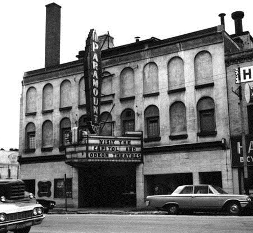Paramount Theatre, originally the Hext Carriage factory, was remodelled into a theatre in 1913. It was known as the Brant Theatre. In 1951 Paramount Theatres bought the theatre and changed the name to the Paramount. The theatre showed its last film on 6-May-1961.  Image courtesy of the Brant Historical Society