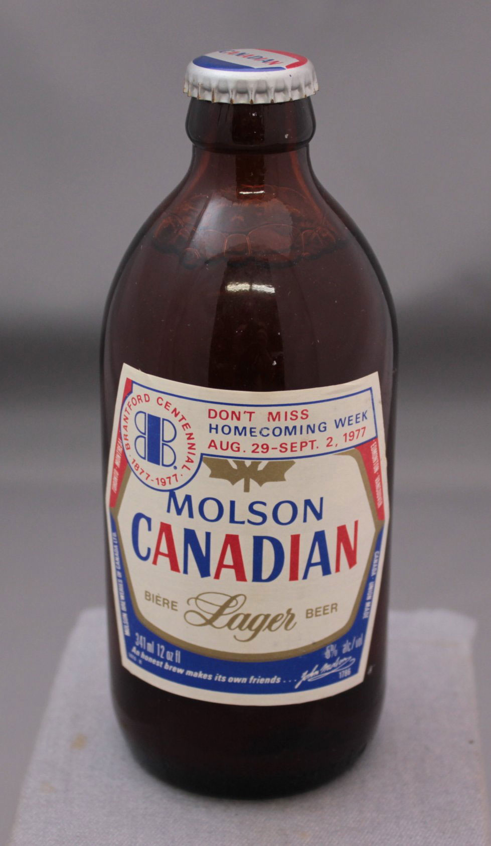 Molson Canadian beer bottle promoting Homecoming Week during the Brantford Centennial.  Image courtesy of the Brant Historical Society