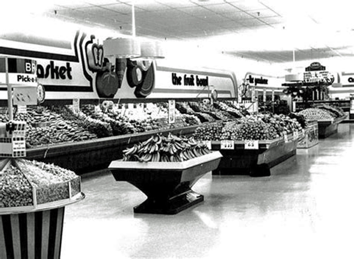 Calbeck's fourth store in Brantford opened at the North Park Plaza on Fairview Drive in 1979. This photo shows the in direct lighting used in the store. The lights fixtures hang down from the ceiling and cast the light upwards to reflect off the ceiling.  Image courtesy of the Brant Historical Society