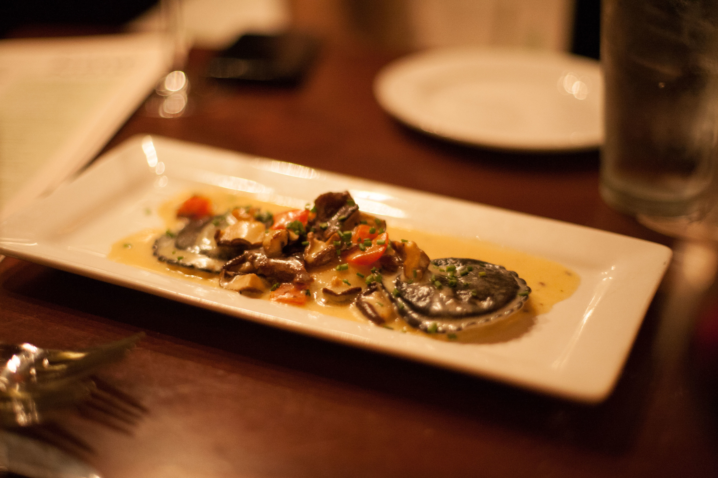 Black & White Lobster Ravioli: squid ink & egg pasta, shiitake mushrooms, sherry-lobster sauce.