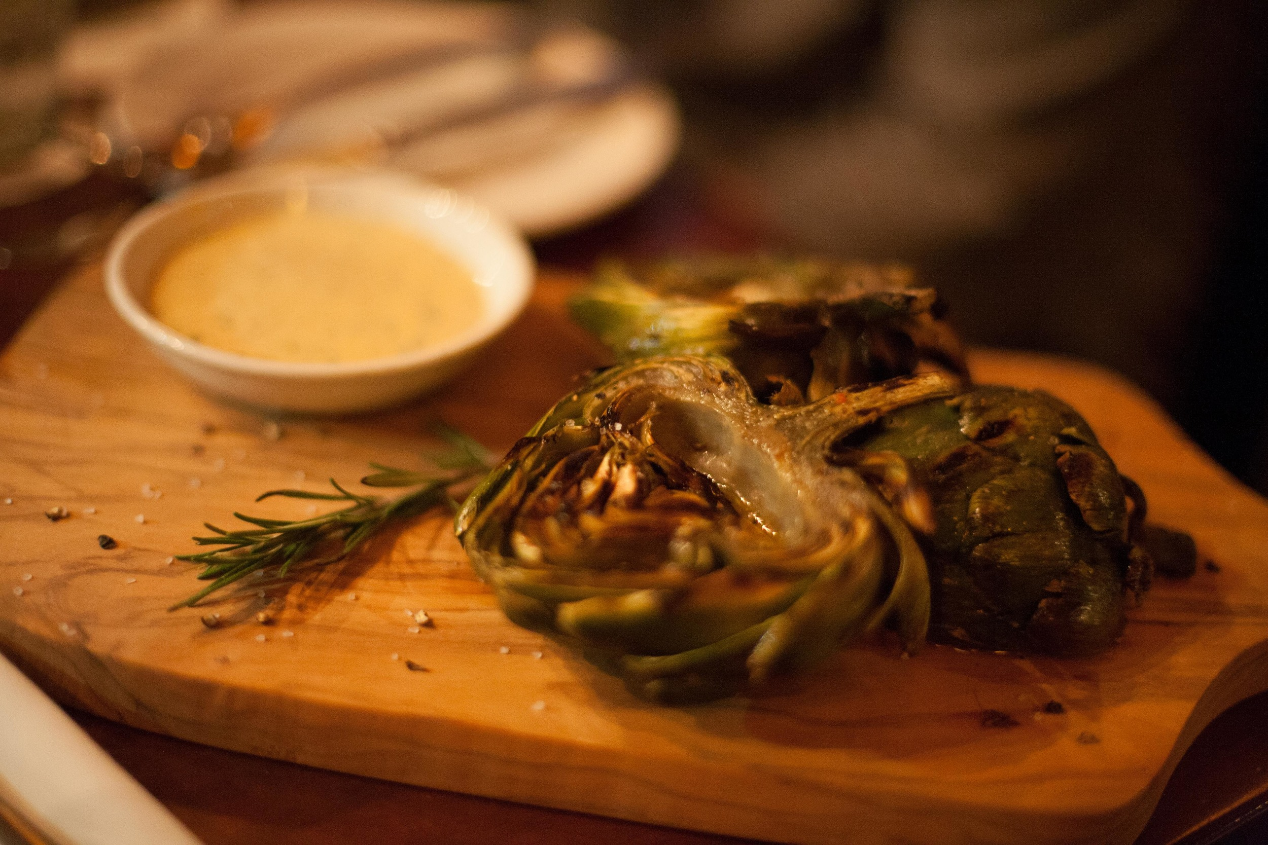 Oak-Grilled Artichokes served with a Chef-Blended remoulade.