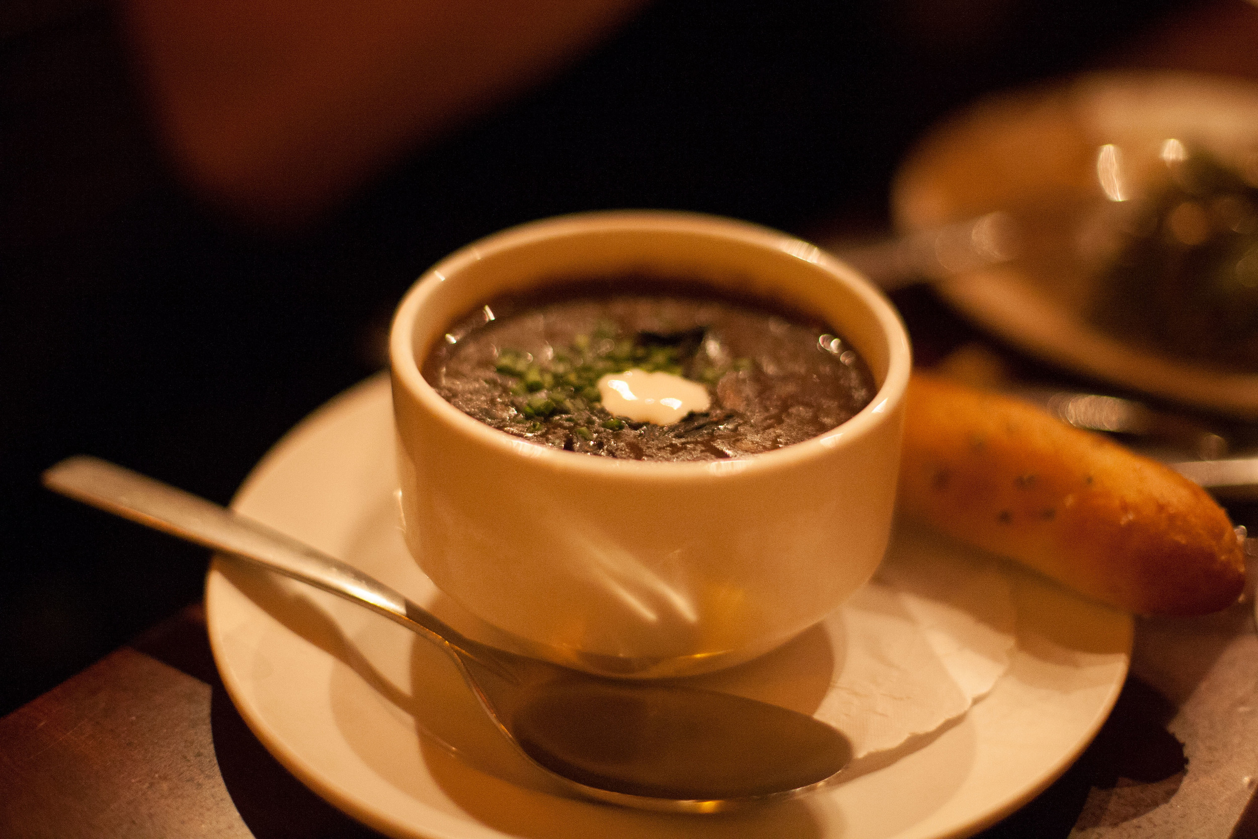 Porcini Mushroom Bisque with sour cream and Black Trumpet mushrooms.