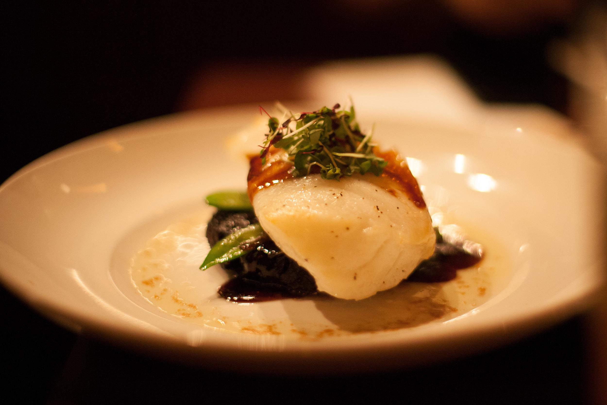 Asian-Glazed Chilean Sea Bass: Organic black rice, snow peas, shiitake mushrooms, micro wasabi.