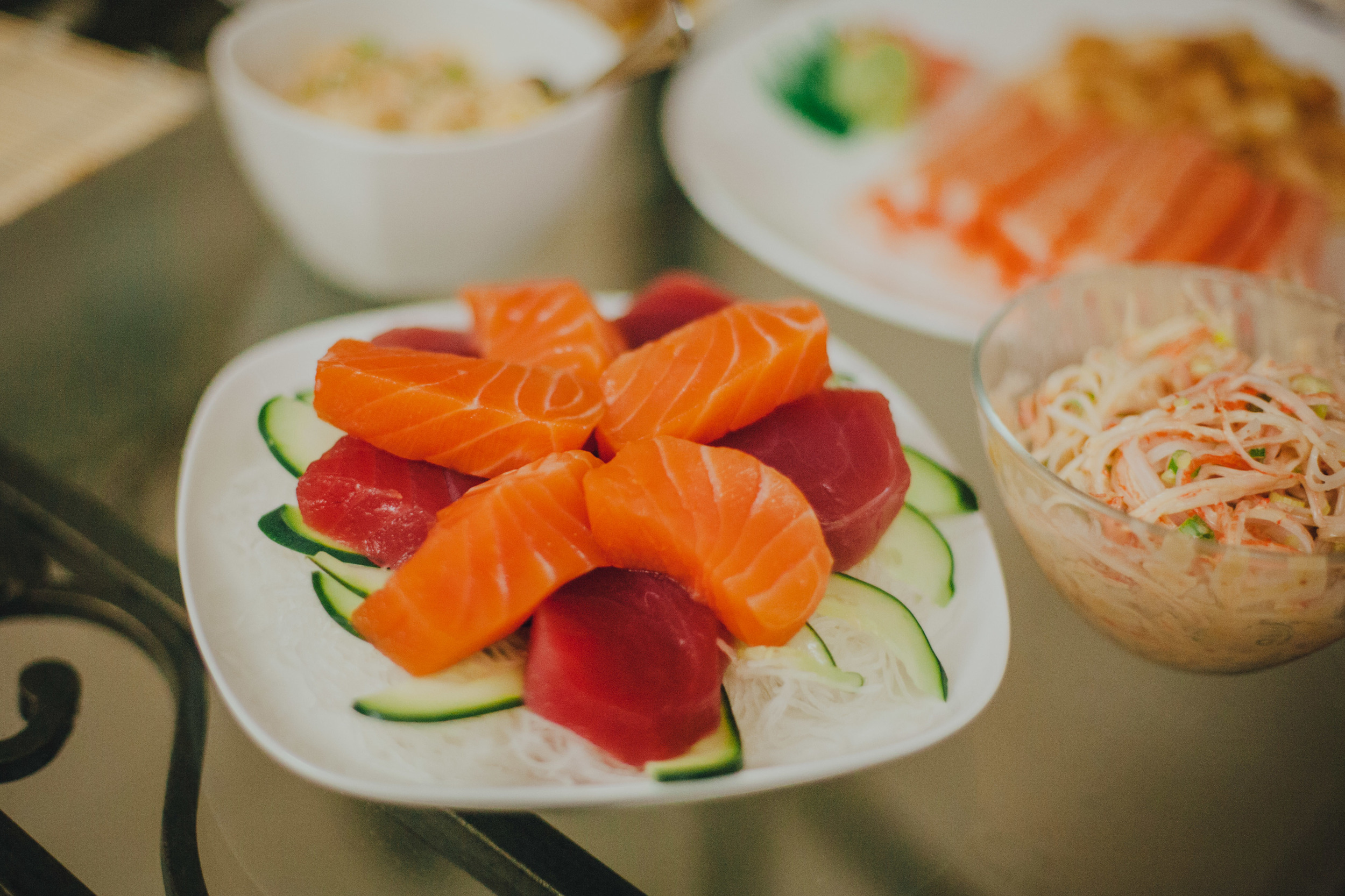 Sliced salmon & tuna sashimi, served over a bed of daikon & sliced cucumbers.
