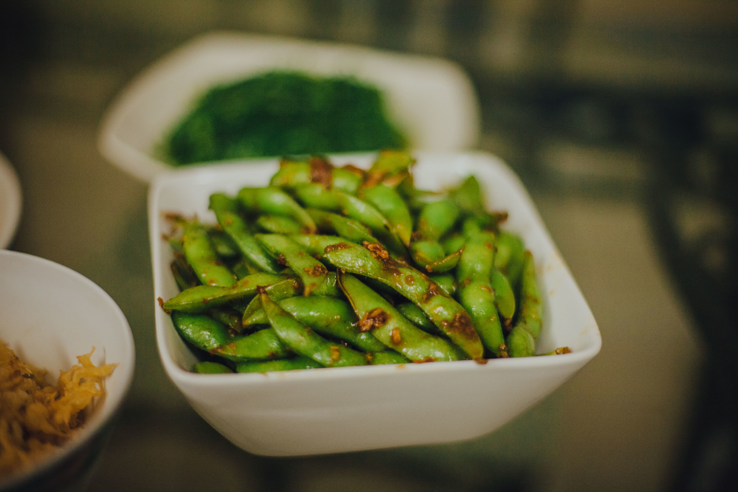 Steamed edamame sauteed with minced garlic & a special soy sauce blend.