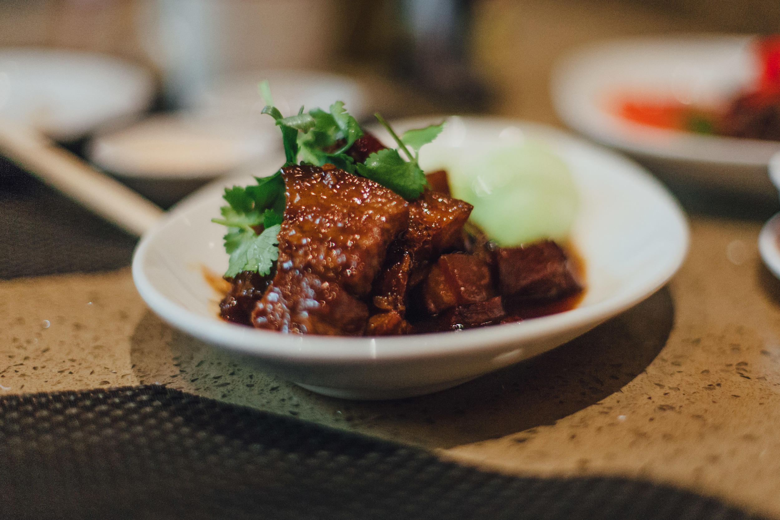 Braised Pork Belly: Pork belly simmered and braised in a thick, flavorful sauce.