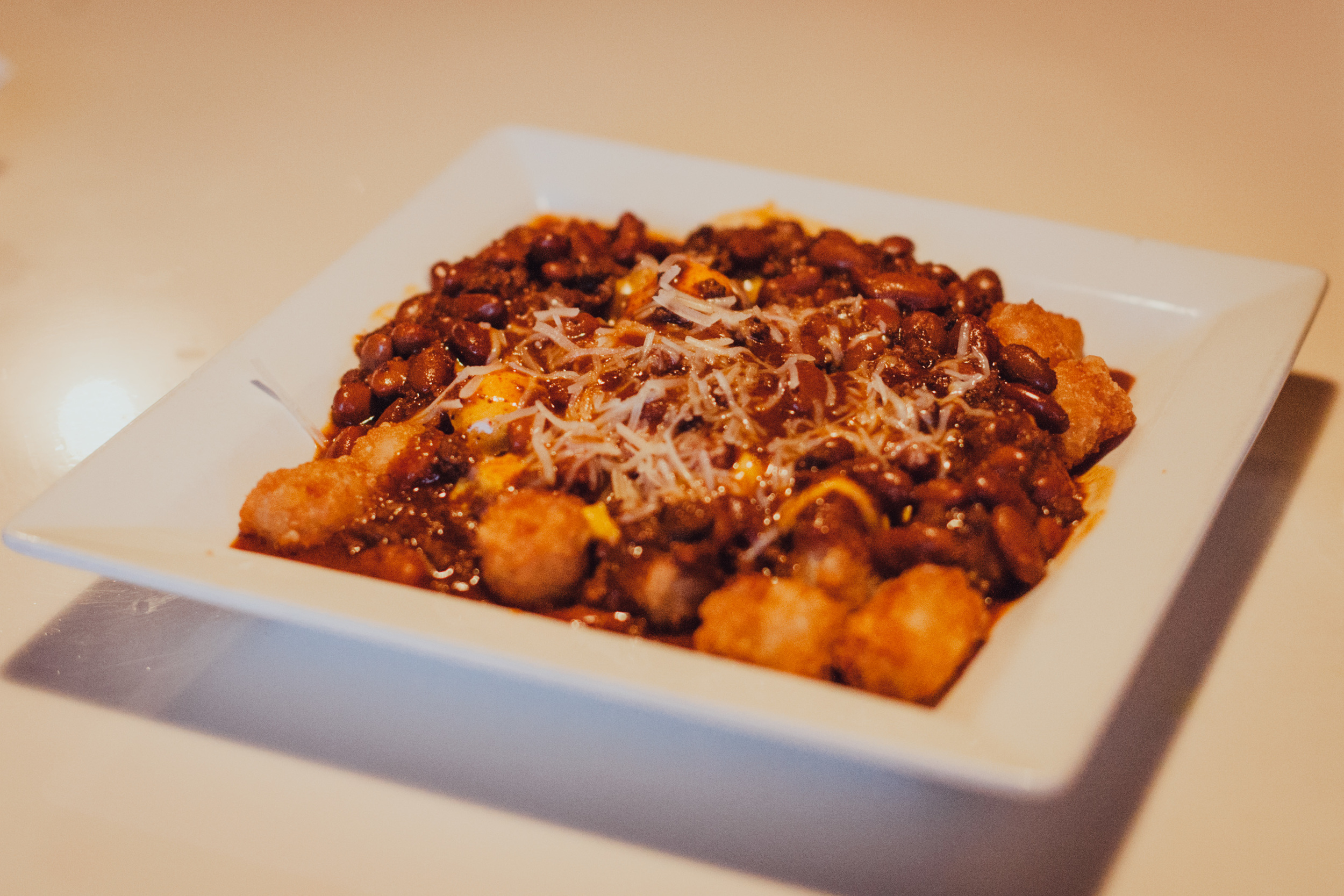Macho Tator Tots smothered with Chili and topped with Shredded Jack & Cheddar Cheese.
