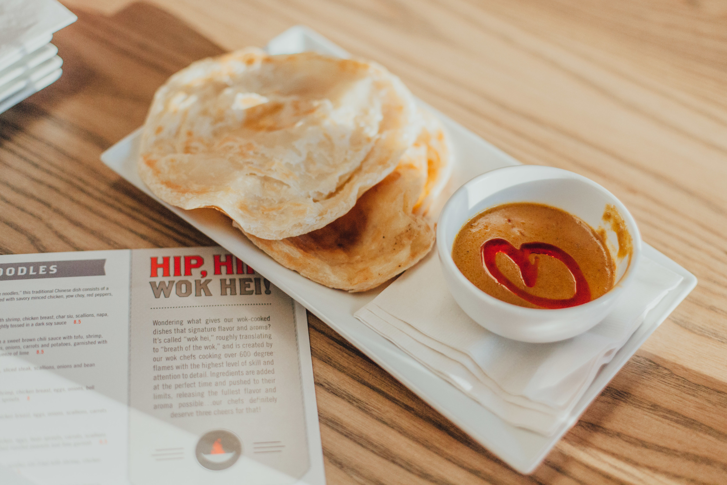 Roti Canai:Malaysian flat bread served with a side of spicy curry dipping sauce.