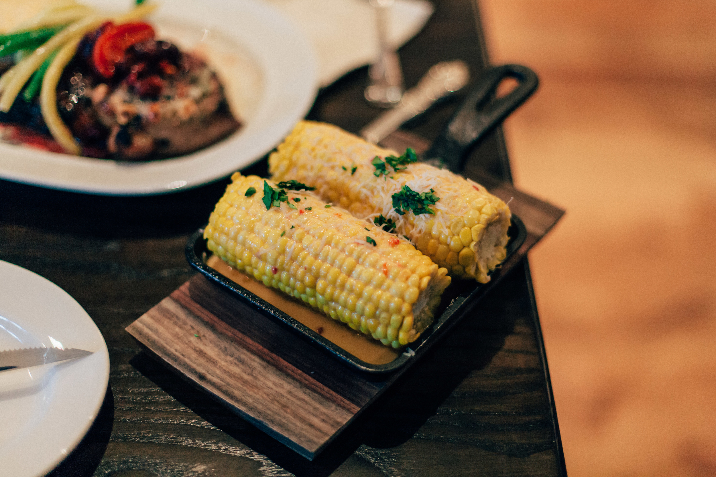 Corn Cobb: Piquillo pepper butter, cilantro, cyprus salt.
