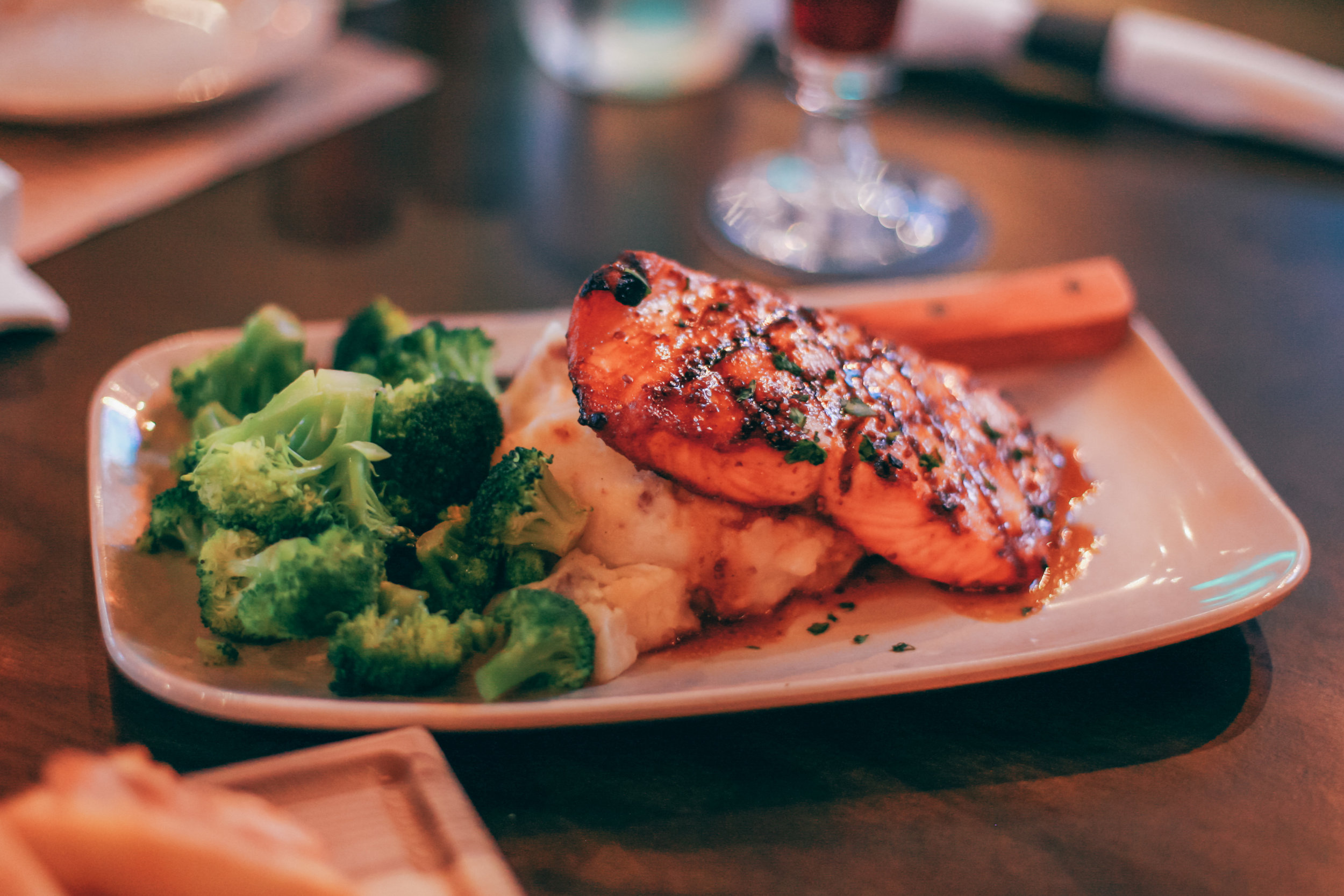 IPA Salmon:Fresh Grilled Salmon, brushed with our Spicy IPA Glaze, Red skin mashed potatoes & steamed broccoli.