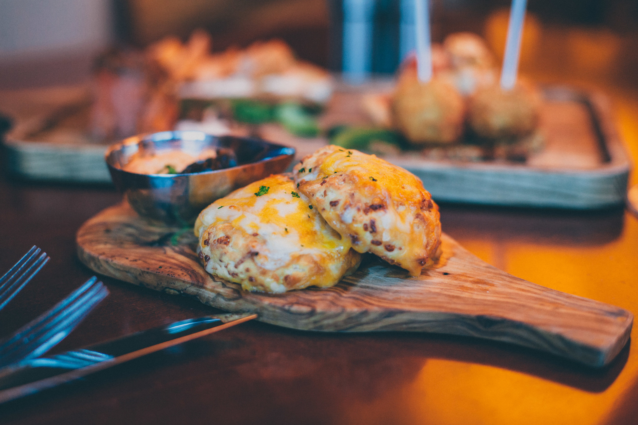 Cheddar Biscuits served with burnt onion jam and pimento spread