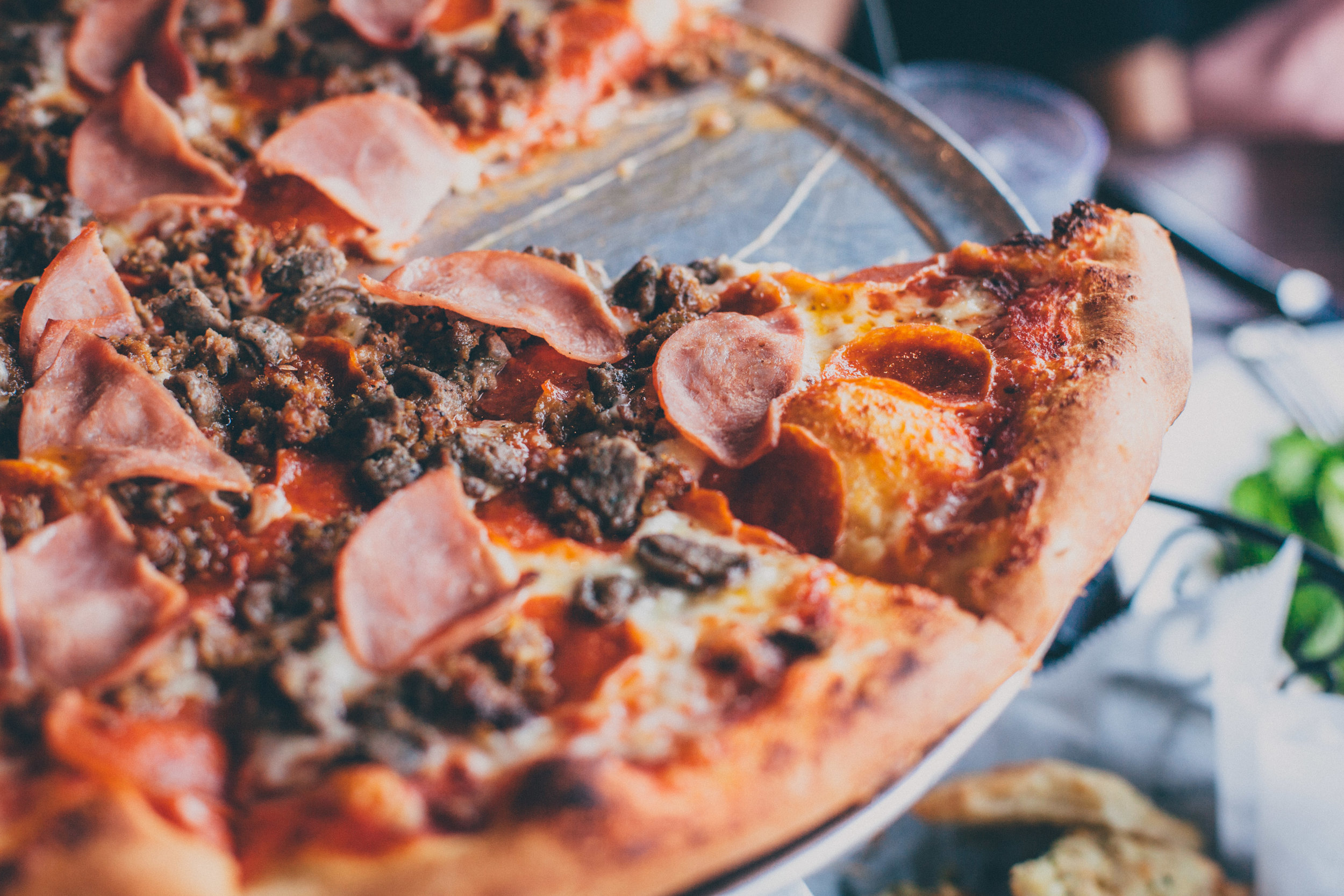 Mulberry Pizza:Crumbled spicy Italian sausage, pepperoni, Canadian bacon, beef, and all-natural mozzarella cheese, with our homemade pizza sauce