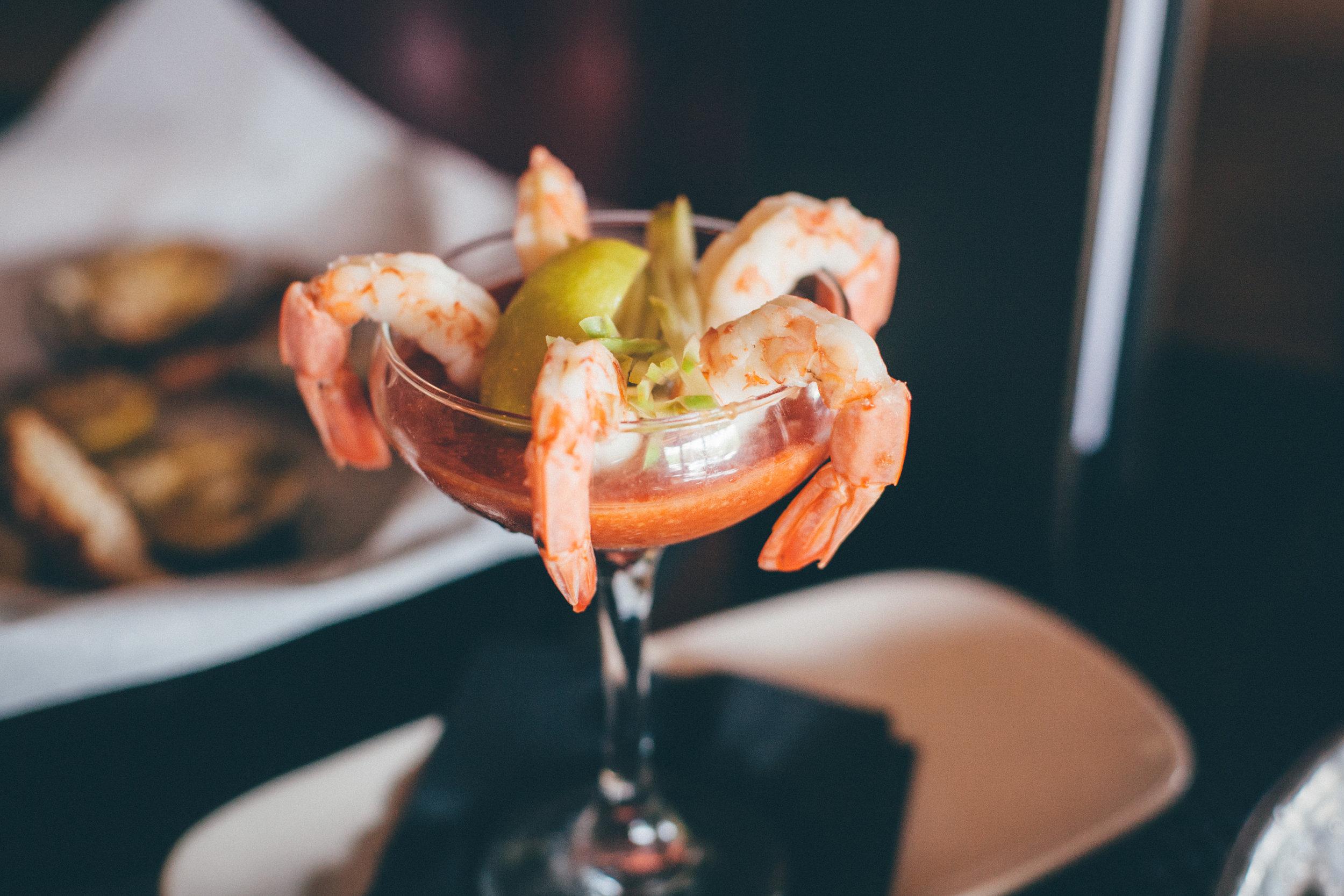 Shrimp Cocktail: Sweet coldwater shrimp cooked until tender, lemon wedges, zesty cocktail sauce.