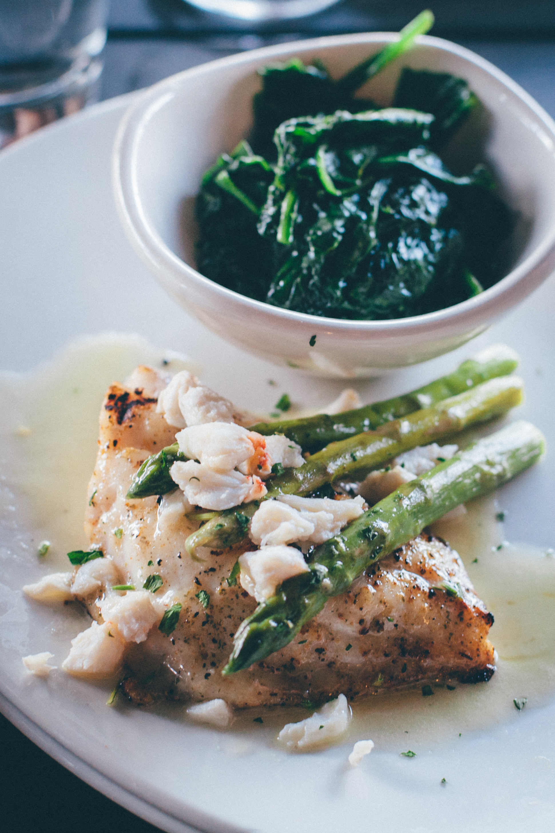 Fresh Grouper Oscar:Wood-grilled wild Grouper, topped with jumbo lump crab, freshly steamed asparagus and lemon butter, served with choice of two sides