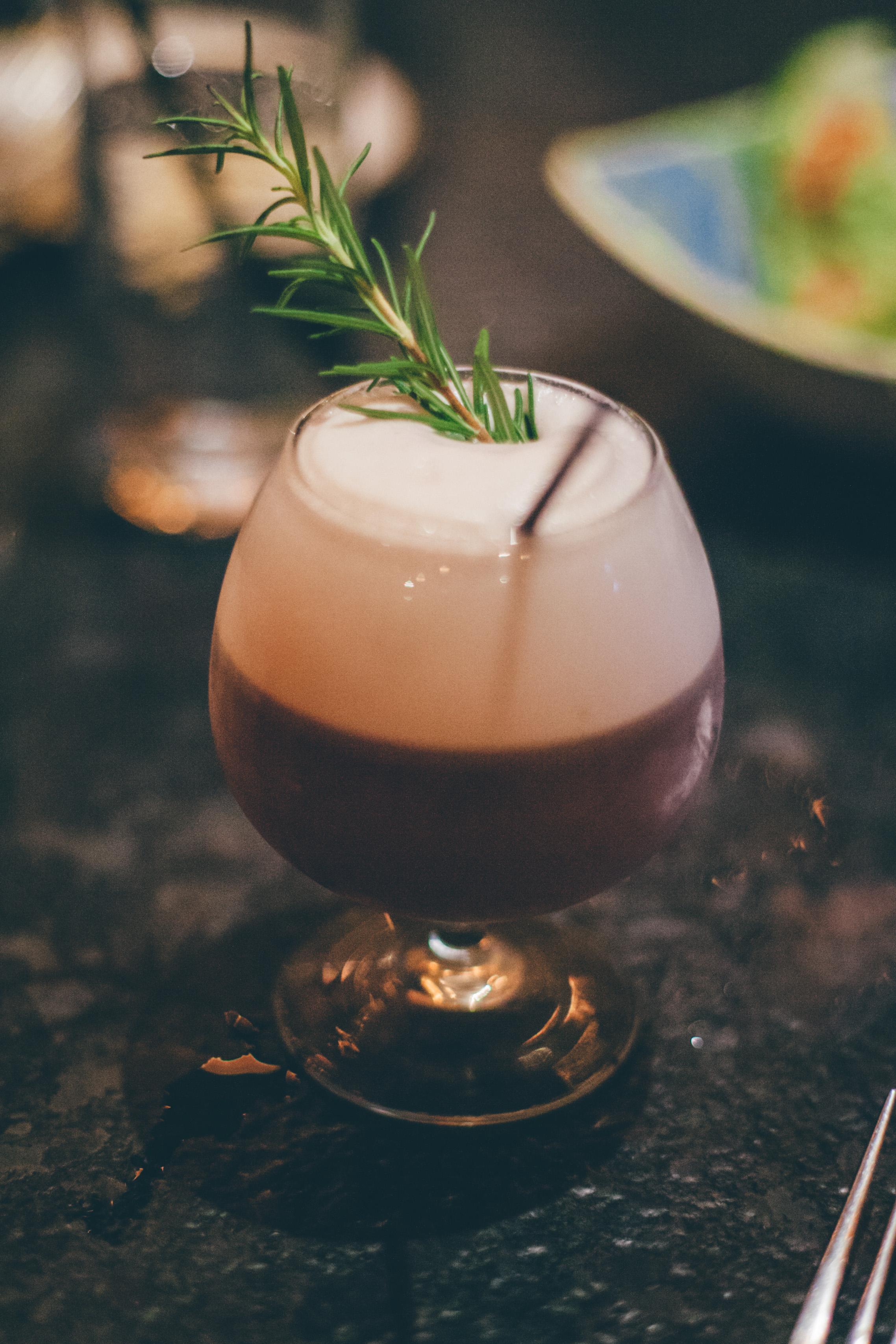 The Abigail:Plymouth Gin, Rothman & Winters Crème de Violette, lemon, blueberries, rosemary, egg white