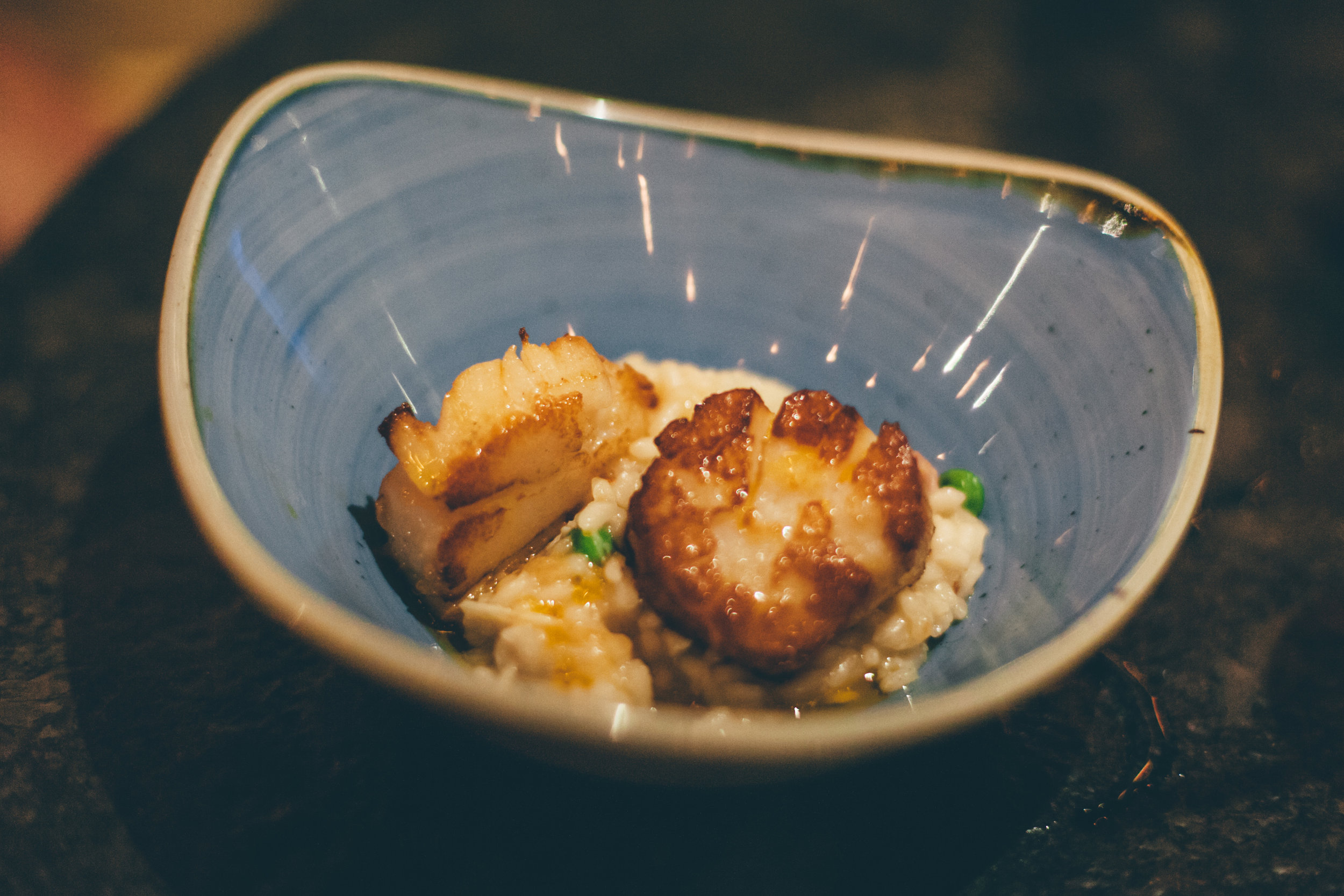 Entree Pan-Seared Diver Scallops:Sweet green pea, bacon and lump crab risotto, chile de arbol oil (Note: Picture is of a half-portion; the server split the entree for us prior to serving)