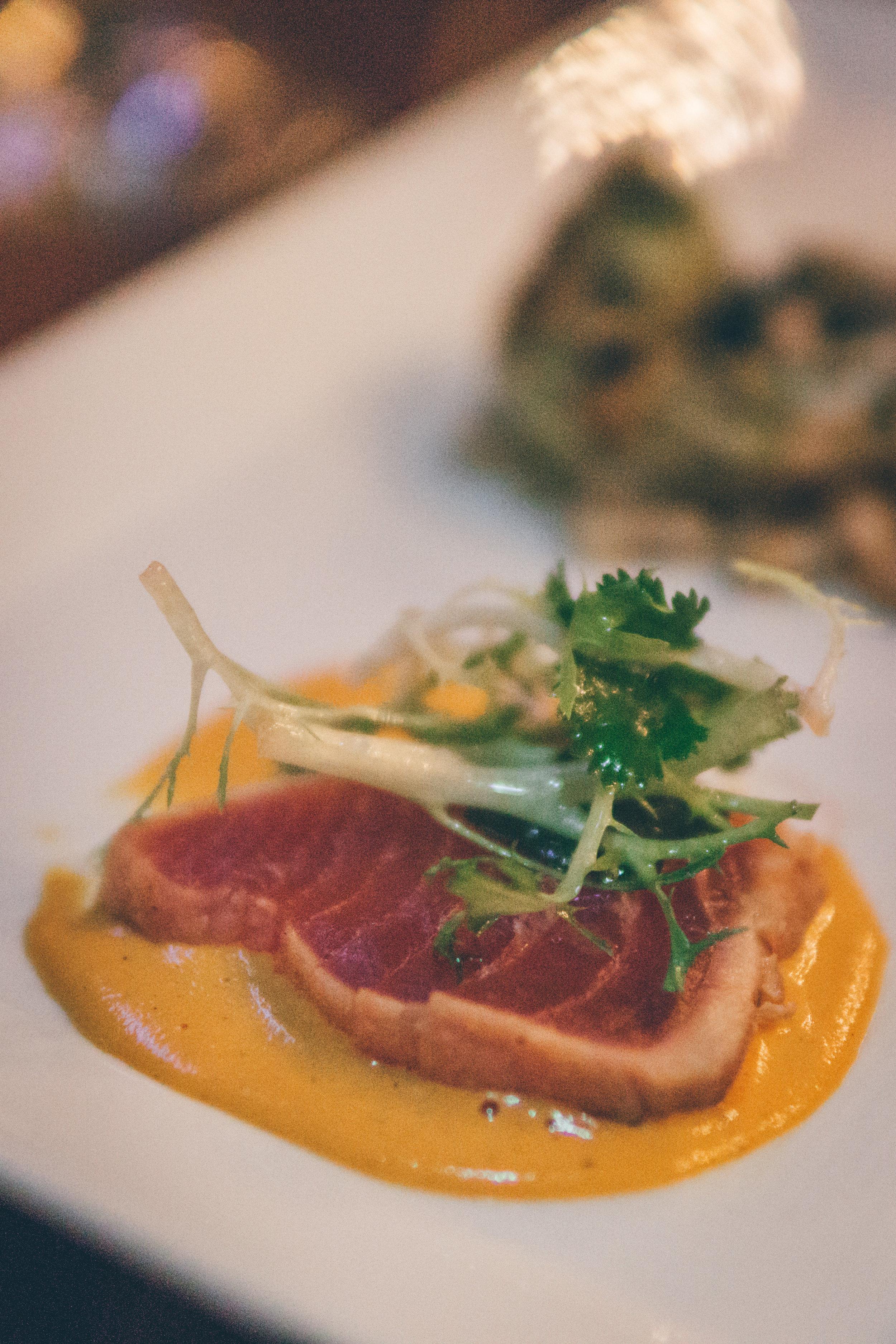 Ahi Tuna Tataki: Cold-Pressed Olive Oil, Radish & Herb Salad, Roasted Peanut Romesco