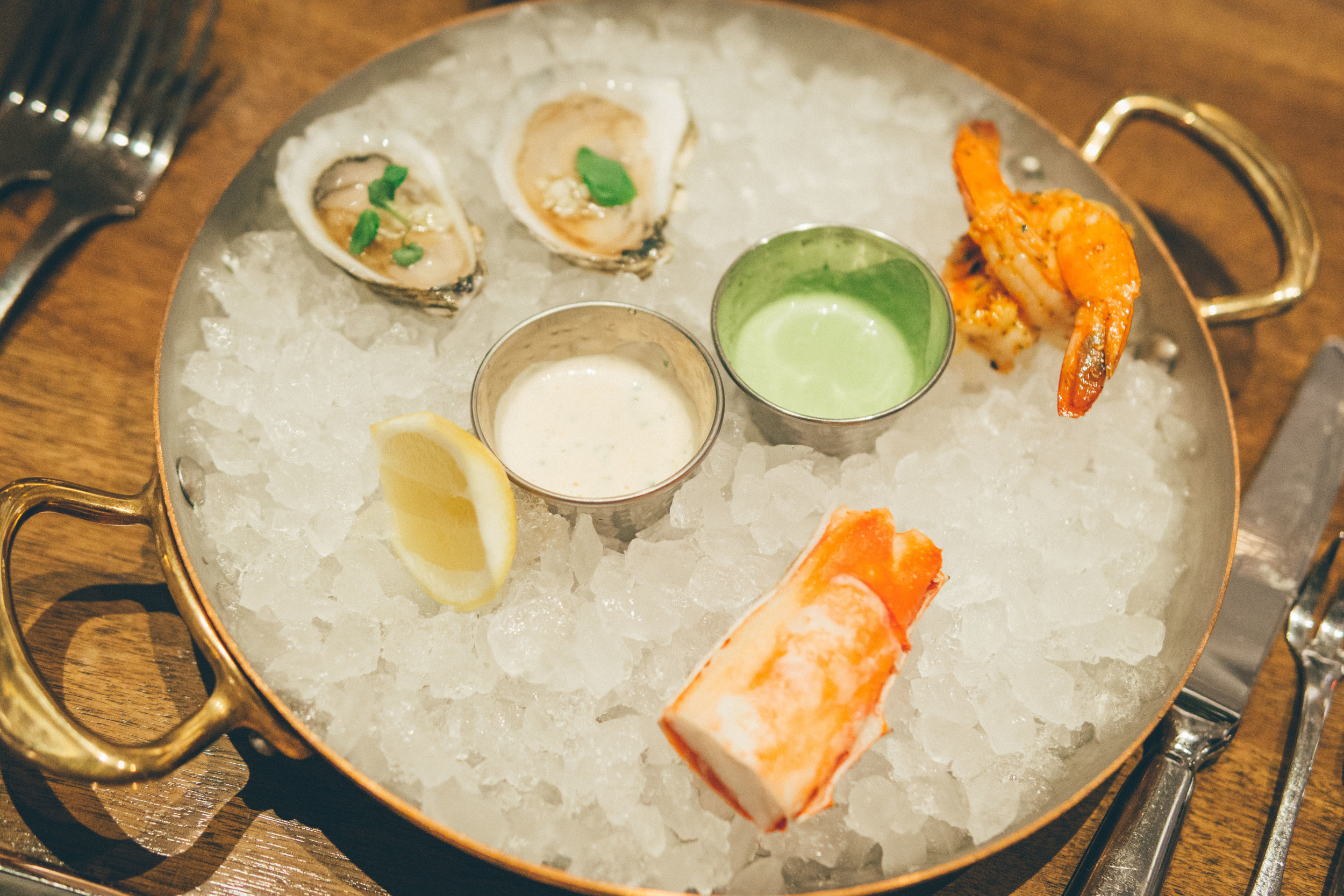 Trio of Seafood - composed oyster, peeled and eat shrimp, king crab