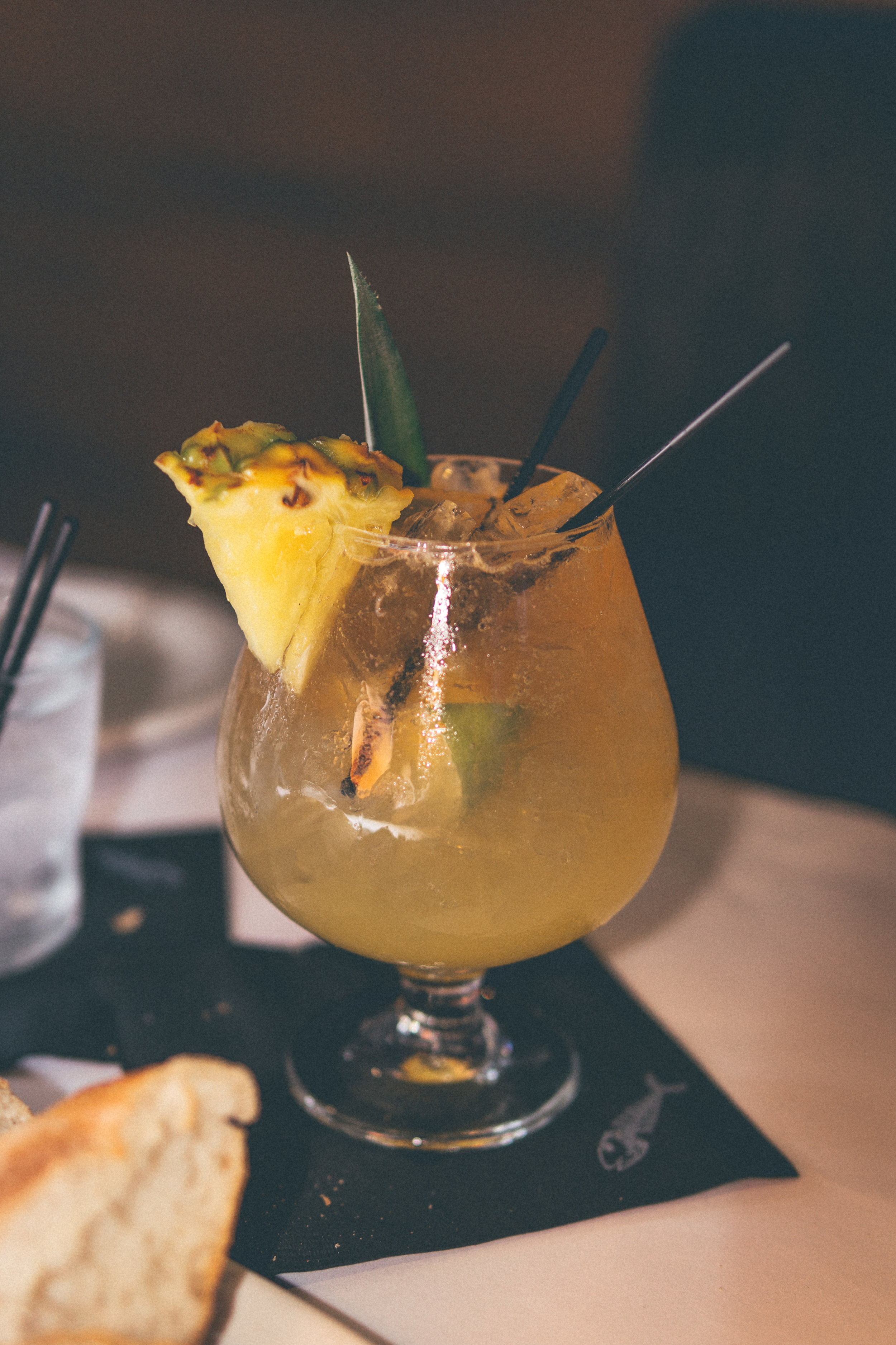 Coral Reef Punch: Bacardi Maestro Rum, Malibu Coconut Rum, passion fruit, house-made vanilla bean simple syrup, fresh-squeezed orange & pineapple juice.