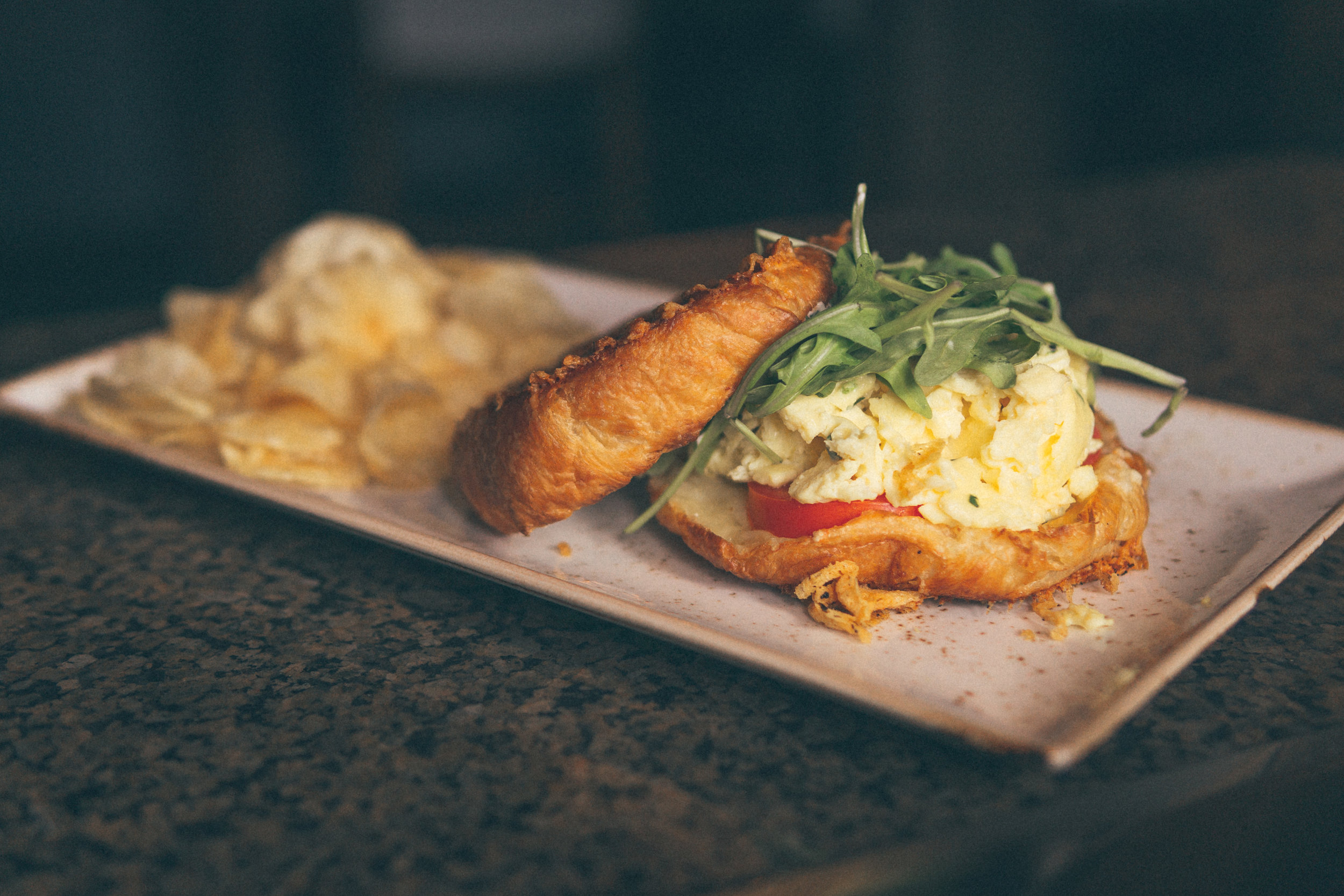 Alpine Egg Croissant: Parmesan-Toasted, Scrambled Egg, Alpine Cheese, Arugula, Tomato, Herbs, Green Goddess