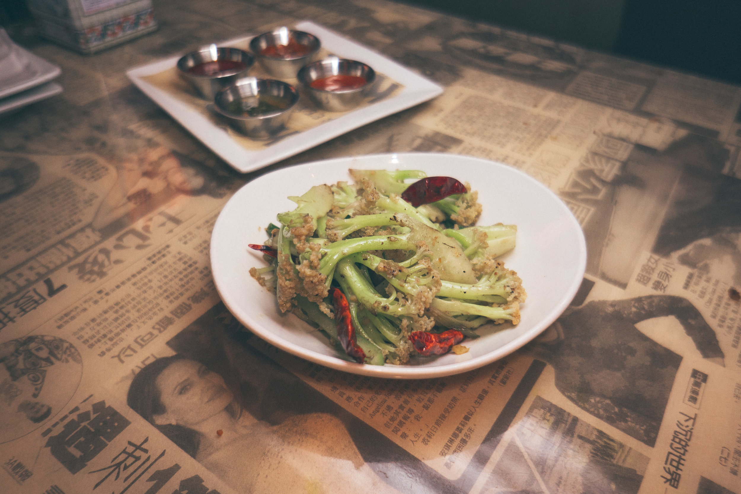 "'Dry Pot""' Caulilini: Caulilini tossed with celery, spring onions, red pepper & Szechuan peppercorn"