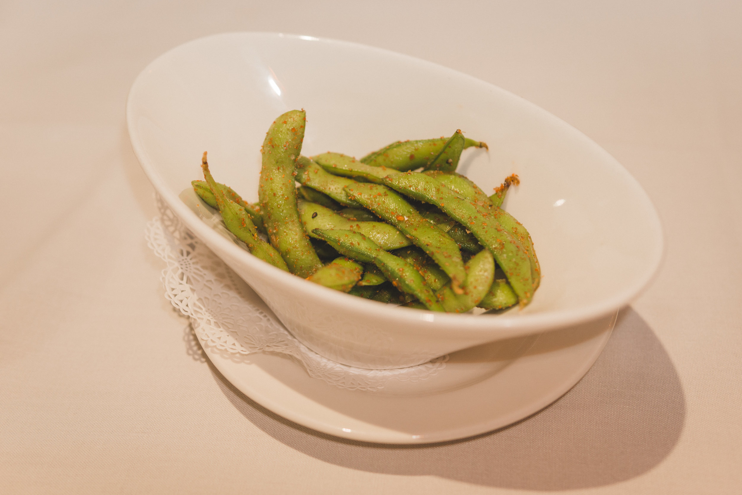 Every meal at Roy's comes with a little taste of edamame tossed with sesame oil, Japanese red pepper seasoning and sugar.