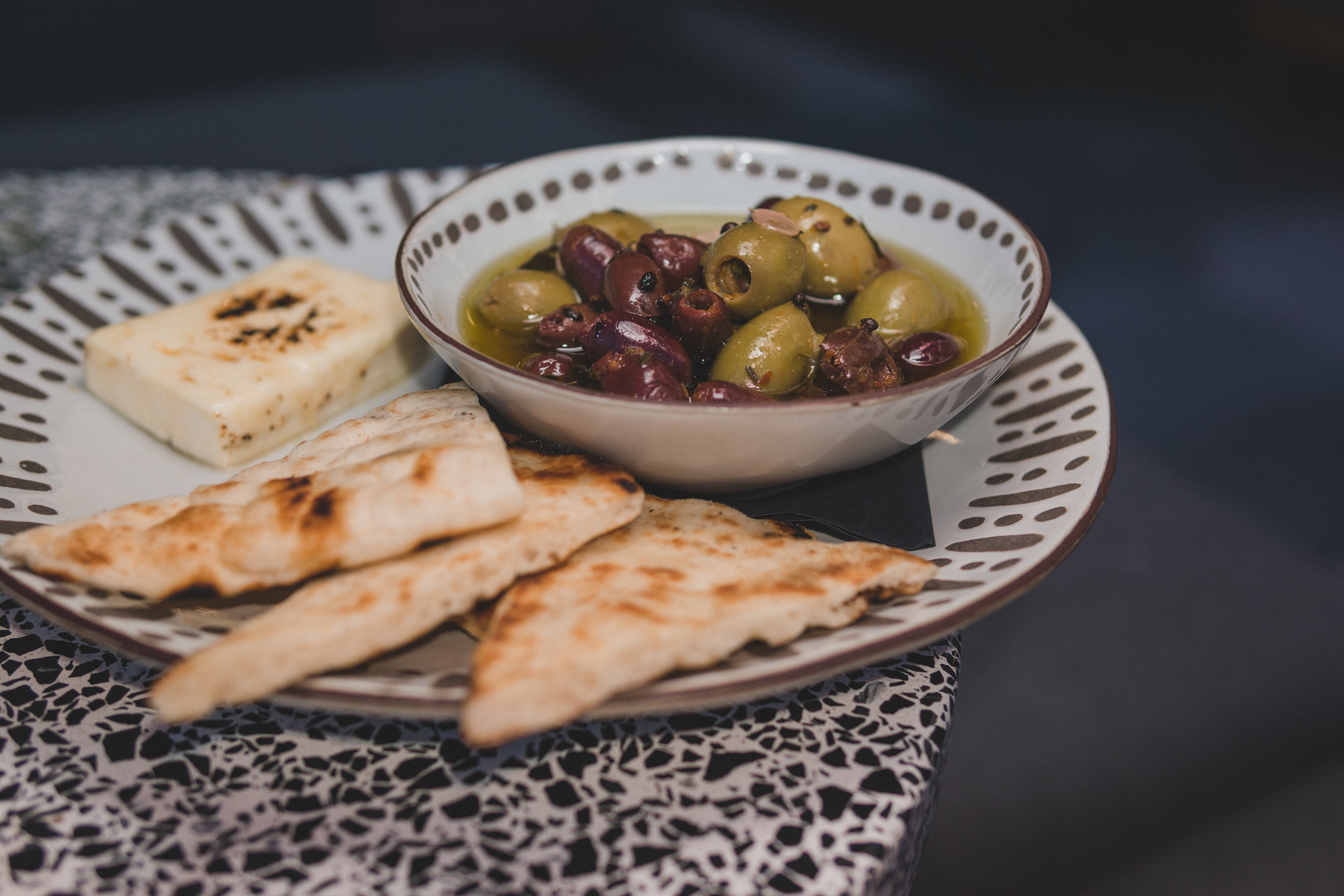 Warm Marinated Olives: Served with grilled naan & feta cheese