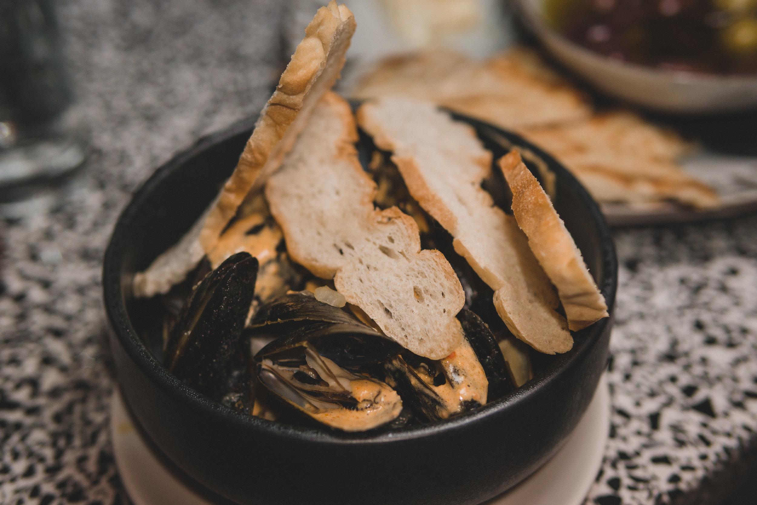 Mussels Billi Bi: Saffron potato, smoked andouille sausage, rouille & toasted baguette