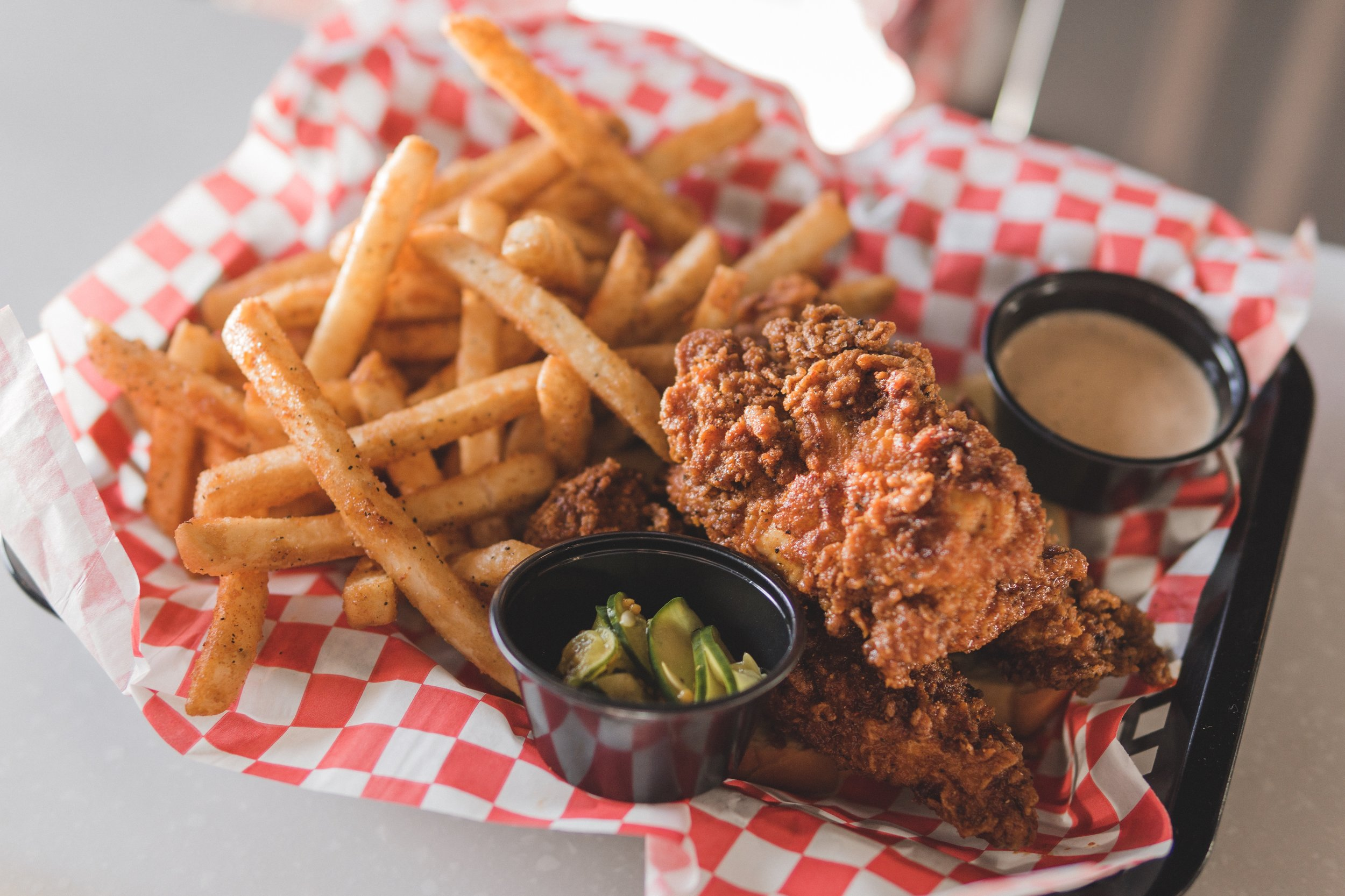 Nashville Hot Tenders, served with crispy fries, King sauce and sweet heat pickles