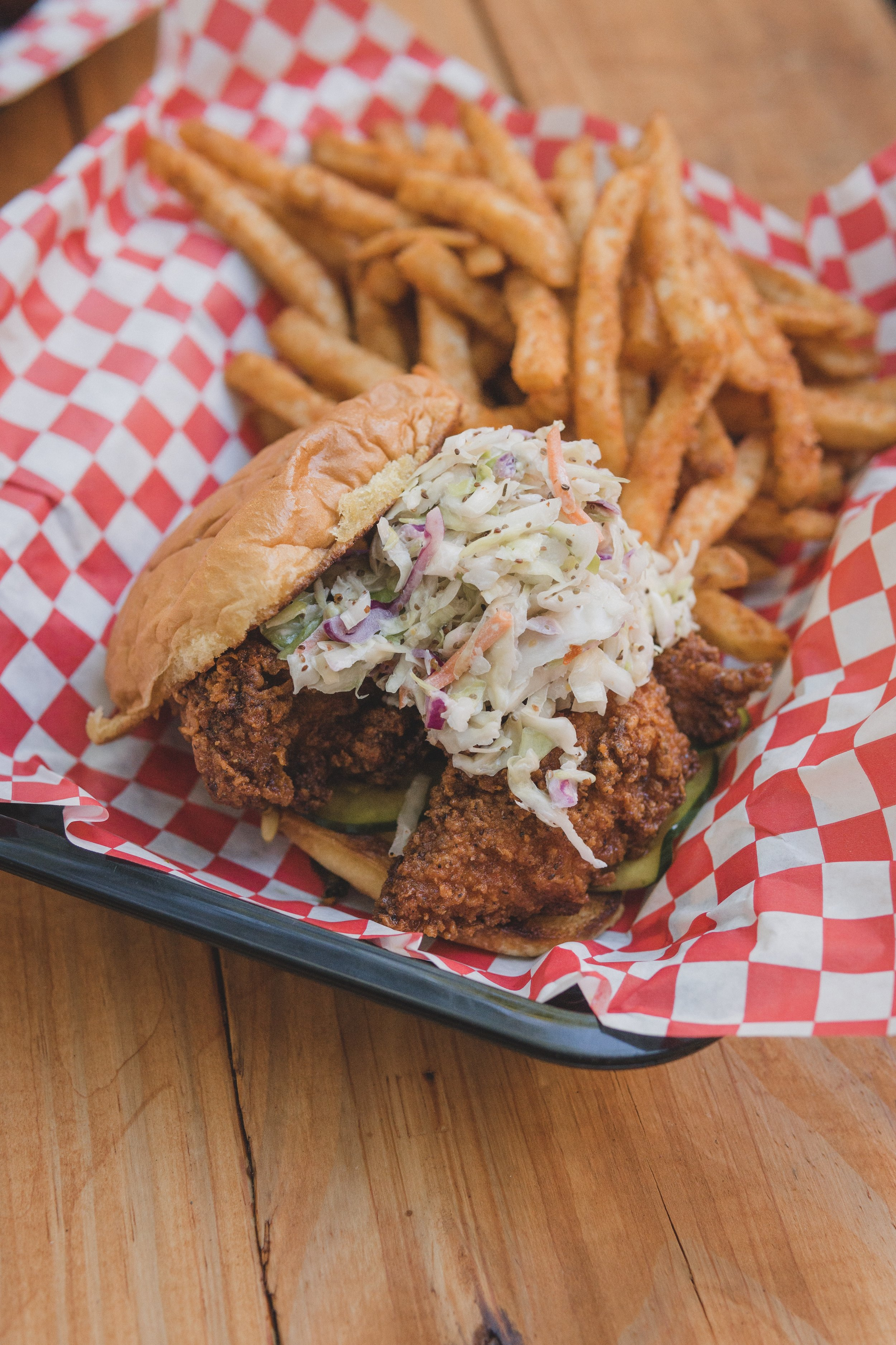 Nashville Hot Sandwich: 2 Nashville Hot tenders, sweet heat pickles, shredded slaw on a toasted bun