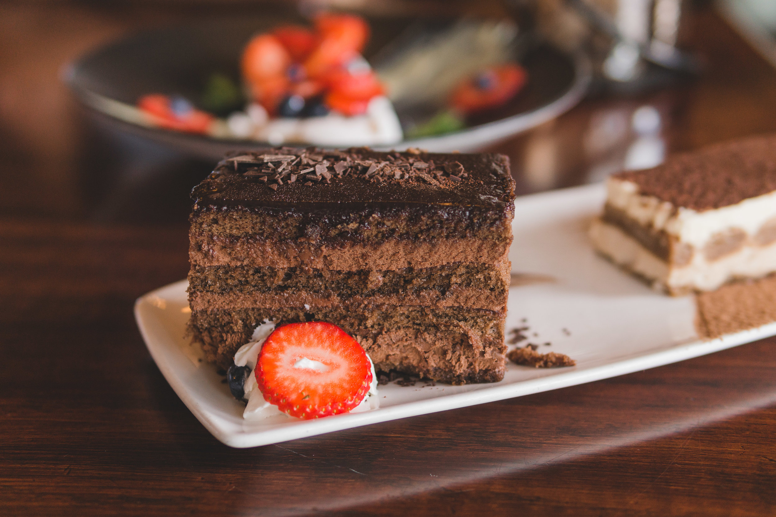 Triple Chocolate Cake: Layer cake, chocolate ganache, whipped cream, strawberry