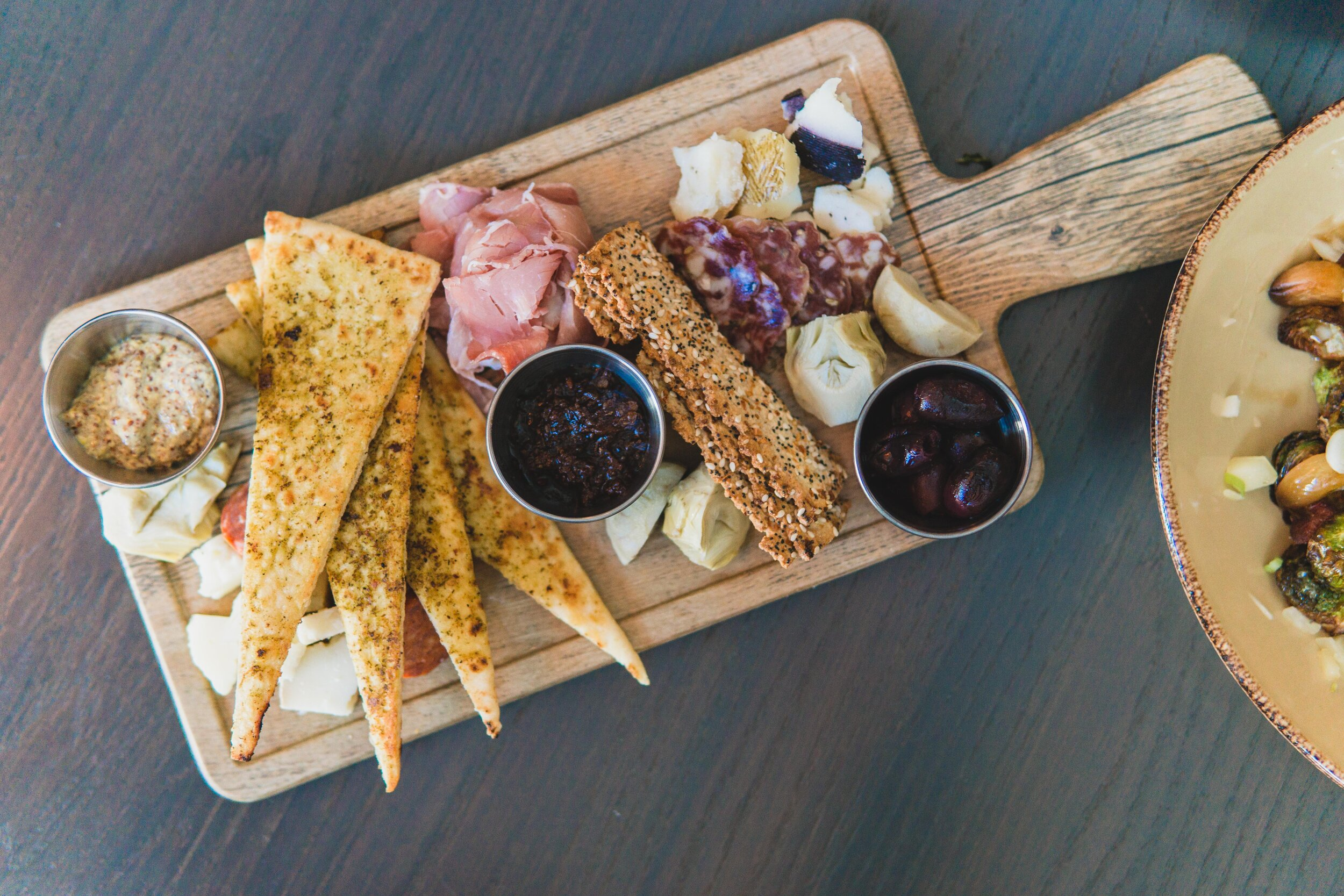 Half Chef's Charcuterie: Spanish cured meats & aged cheese, flatbread crackers, tomato bacon jam, creole mustard & marinated olives