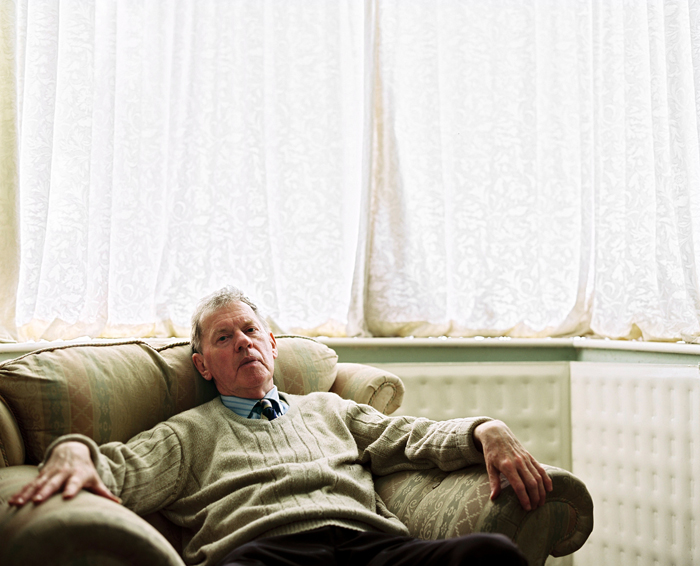 David in the living room of his bungalow. His curtains were always closed, 2010