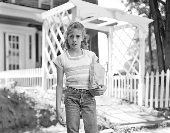 Girl Holding Brown Paper Bag by Christine Osinski